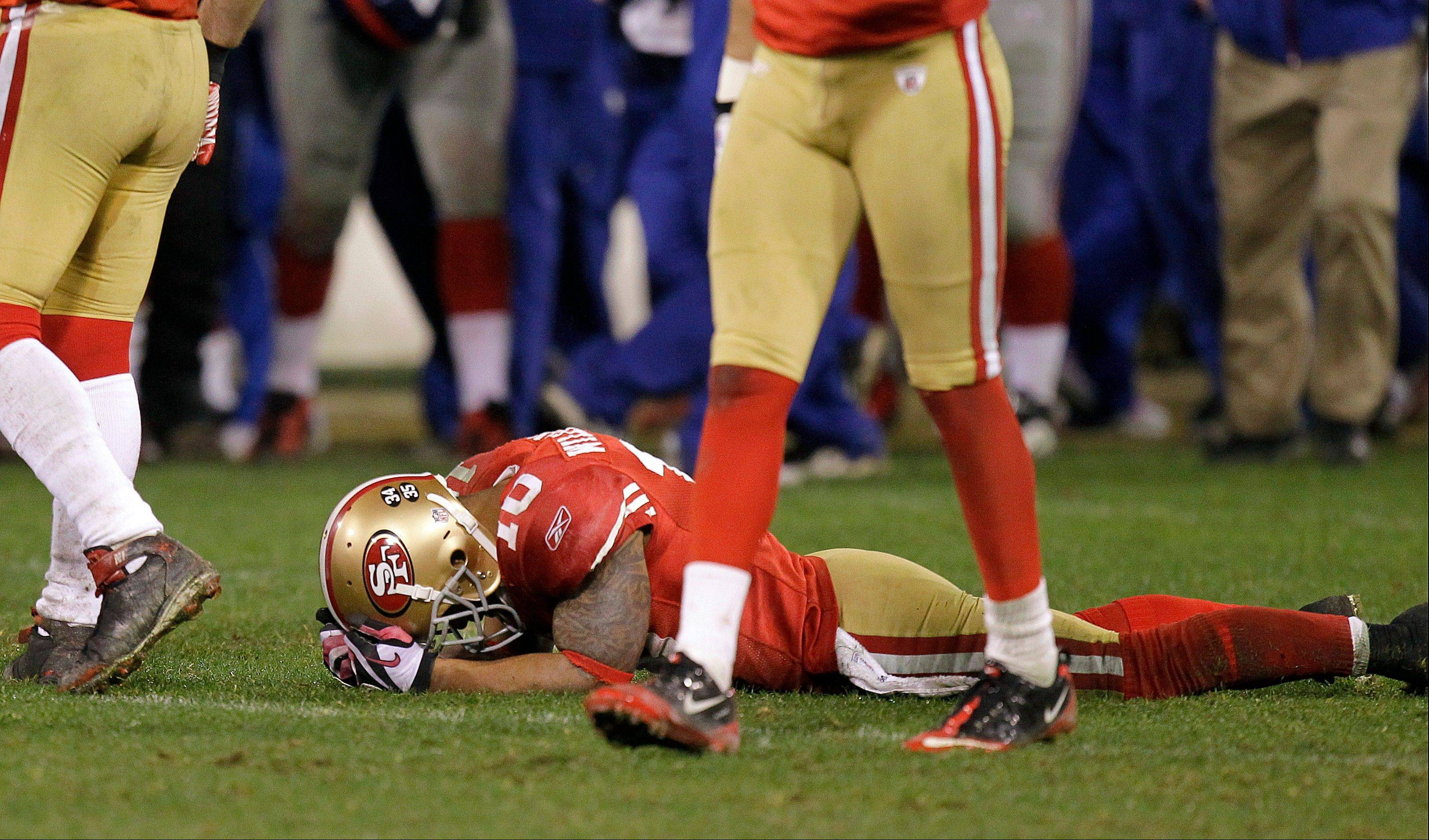 San Francisco 49ers wide receiver Kyle Williams lies on the ground after losing a fumble during overtime of the NFC Championship Game against the New York Giants in 2012.