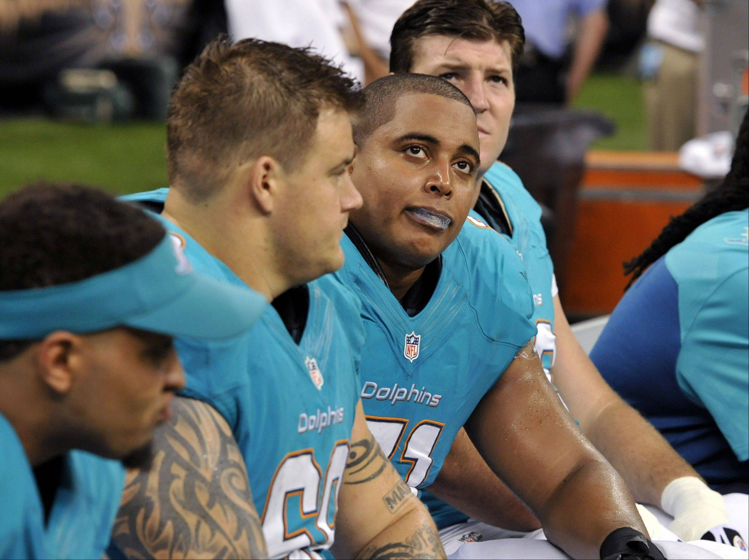 In this September file photo, Miami Dolphins guard Richie Incognito (68), center left, and tackle Jonathan Martin (71), center right, sit on the bench during a game against the Saints in New Orleans. The Dolphins' bullying issue between the two players is just one of the NFL's latest unwanted storylines.