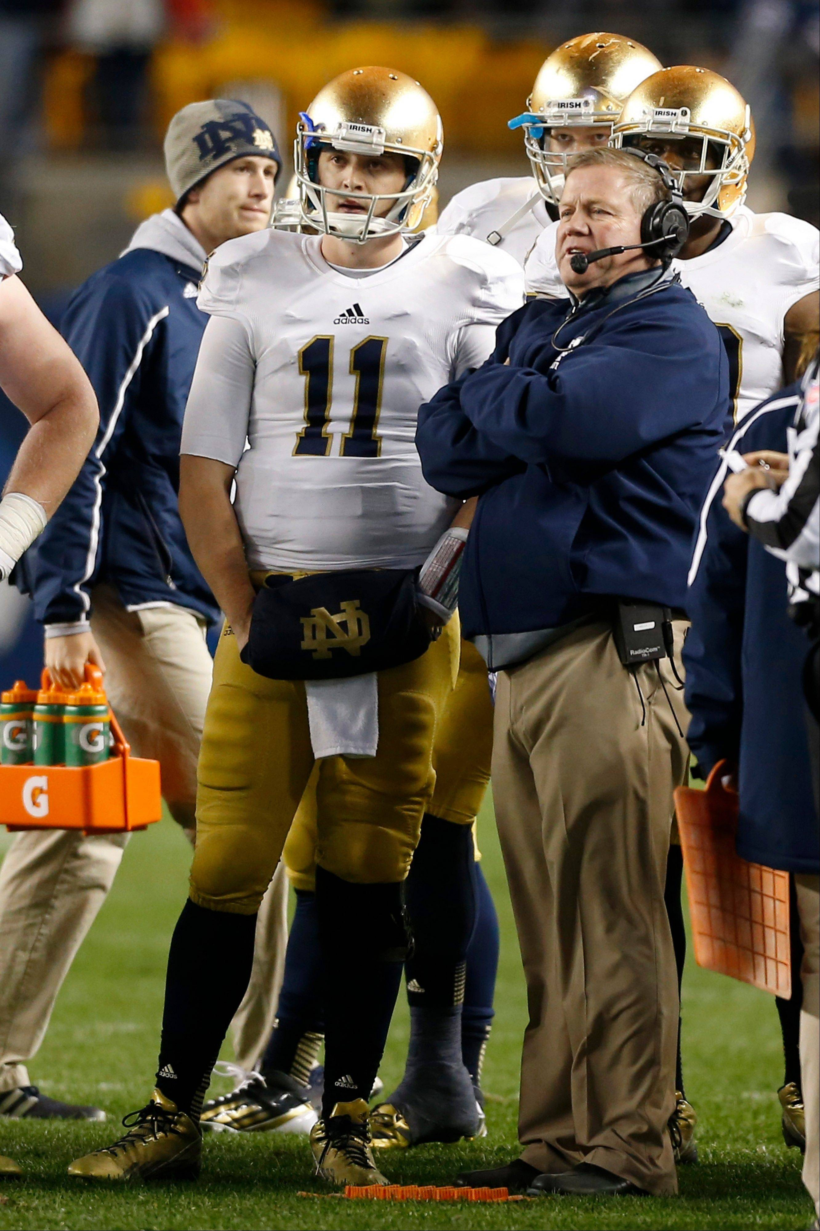 Notre Dame quarterback Tommy Rees talks with head coach Brian Kelly during a timeout in the fourth quarter of last Saturday's loss to Pittsburgh.