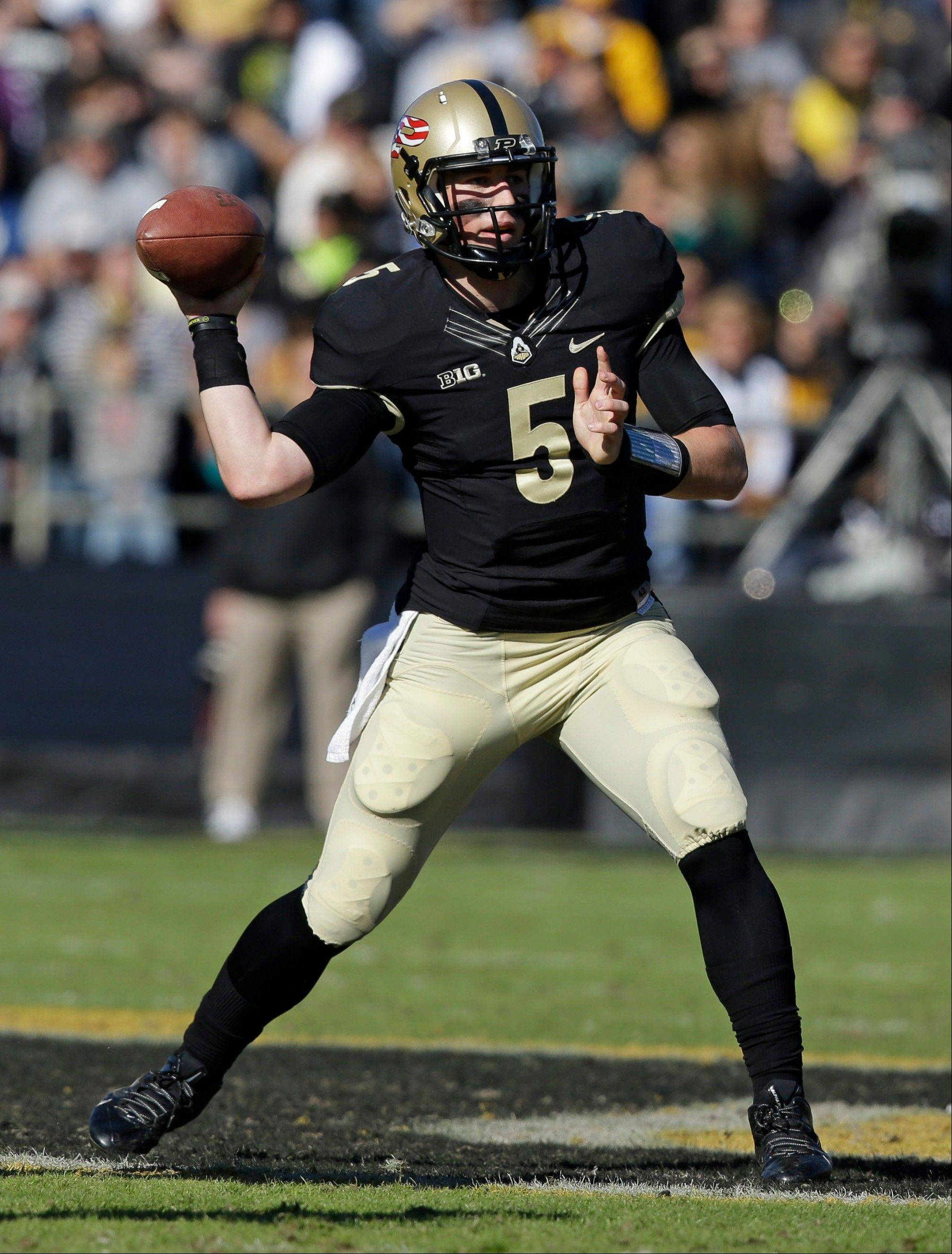 Purdue quarterback Danny Etling throws against Iowa Saturday during the first half in West Lafayette, Ind.