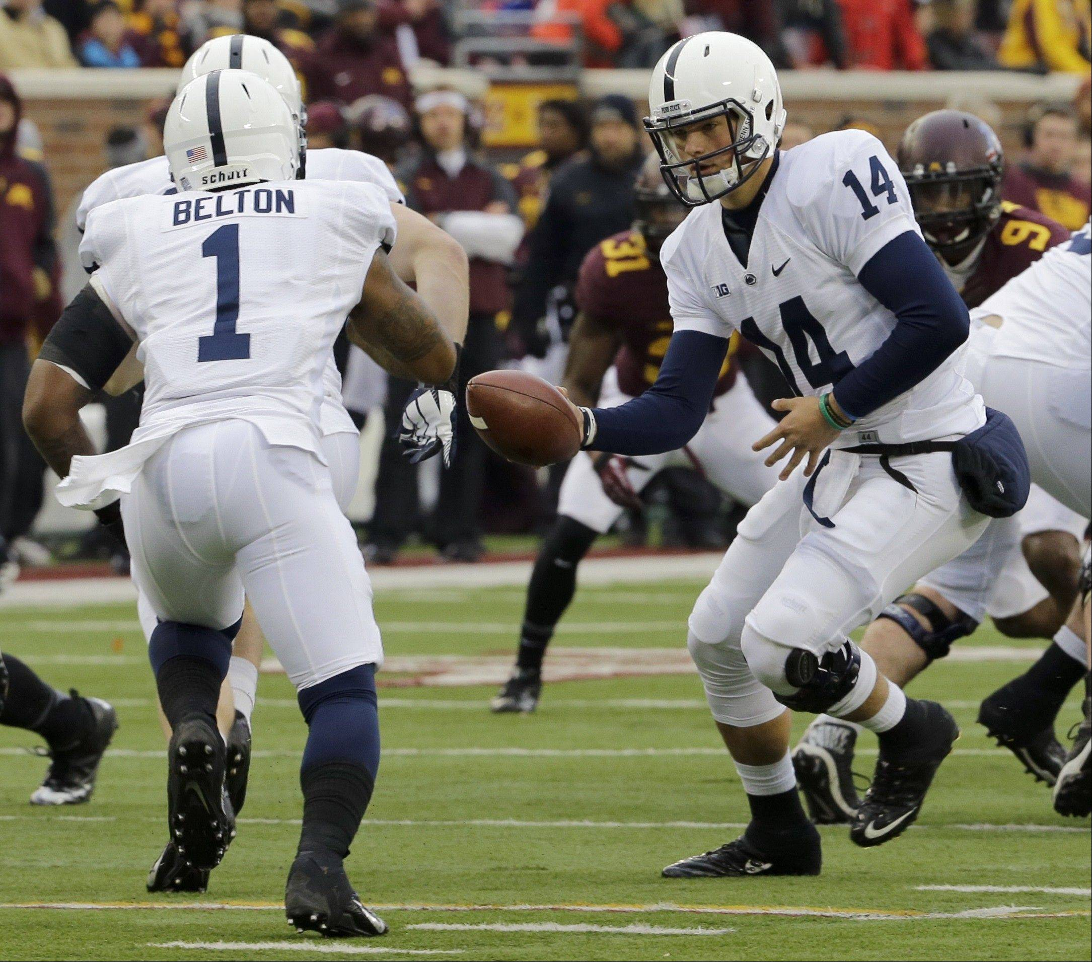 Penn State quarterback Christian Hackenberg hands the ball to running back Bill Belton Saturday during the first quarter against Minnesota in Minneapolis.