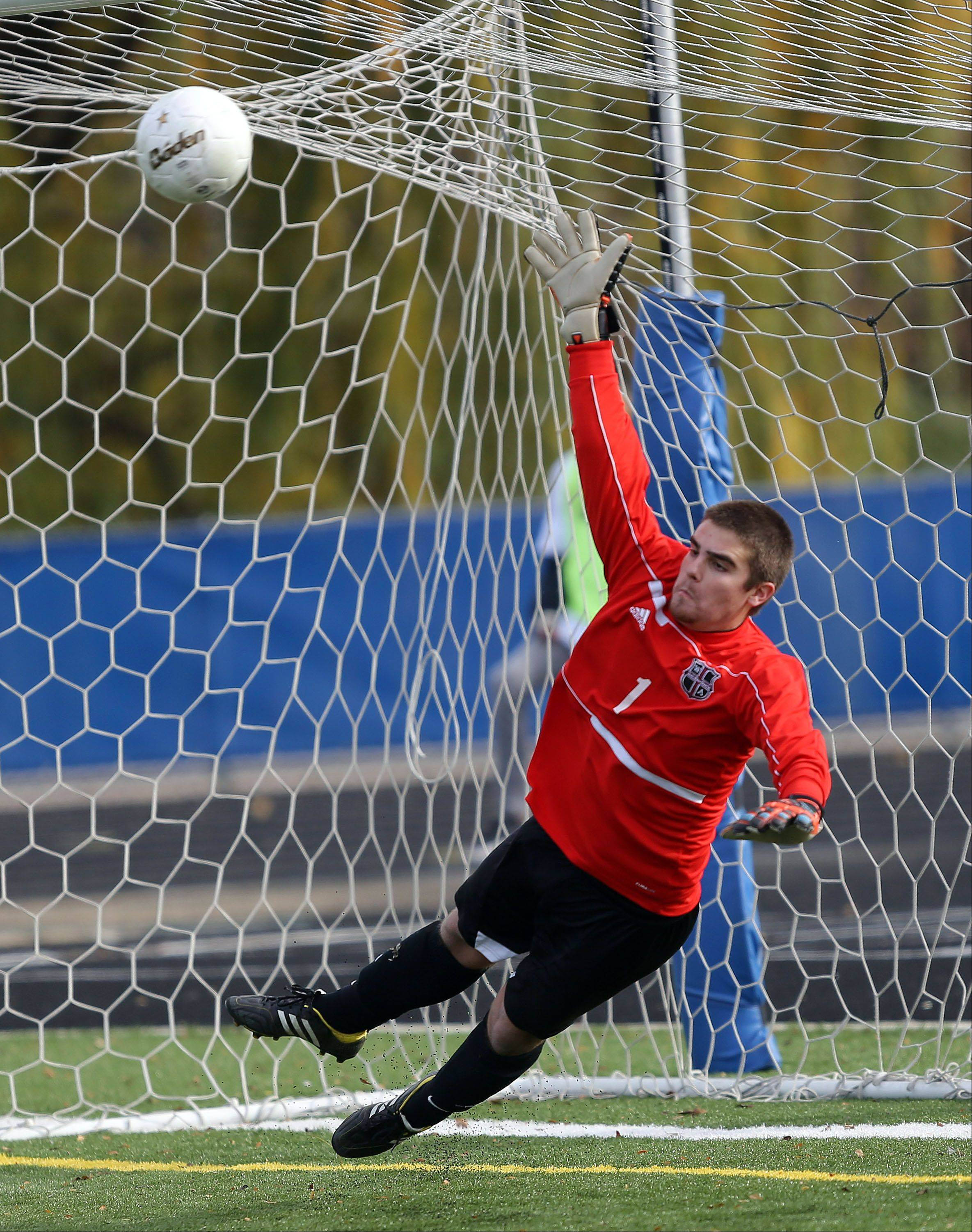 Wheaton Academy's Drew Sezonov makes a diving attempt during Friday's loss to St. Ignatius in Class 2A state semifinal soccer game at Hoffman Estates High School.
