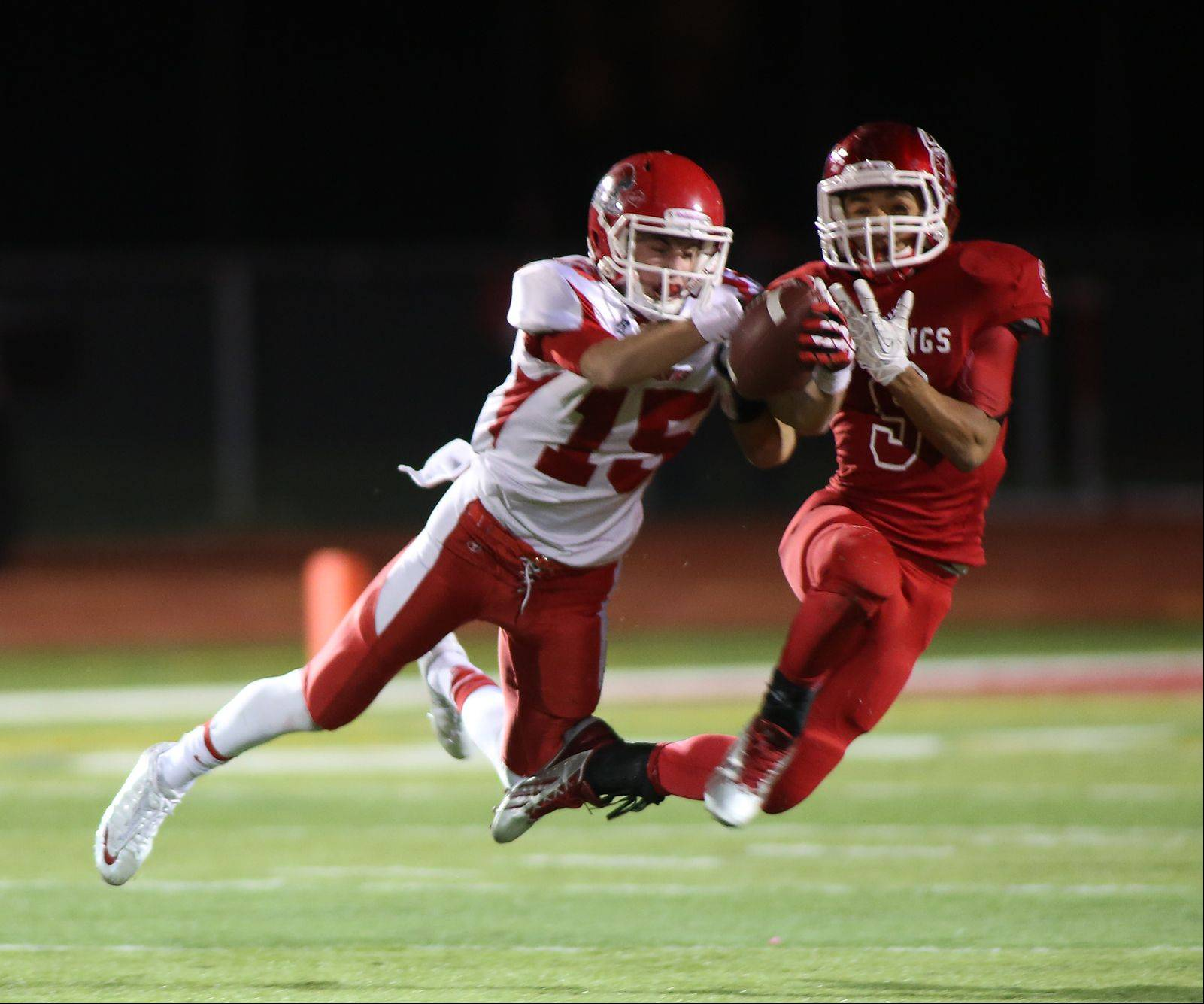 A holding penalty nullifies Naperville Central's Michael Kolzow's interception.