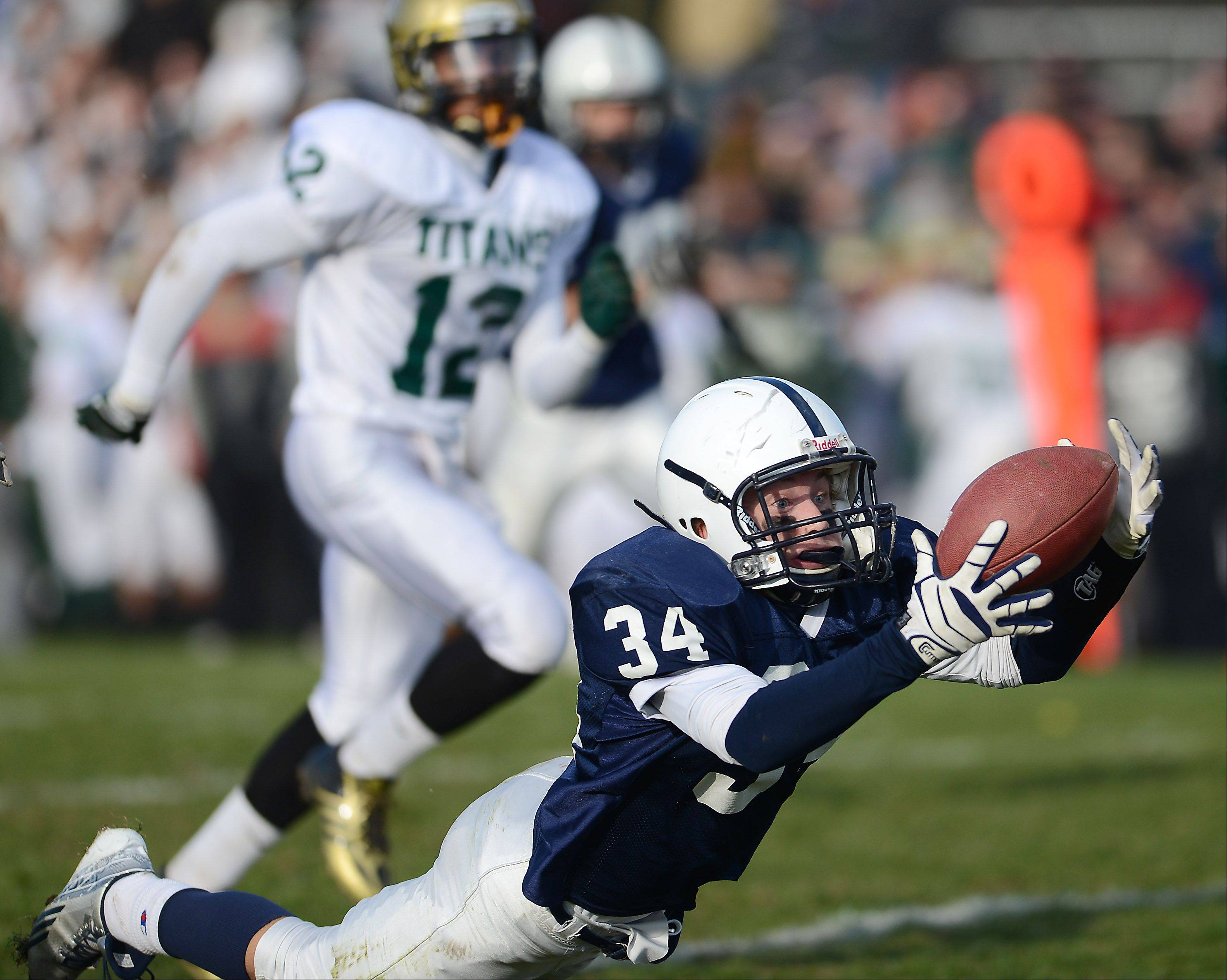 Cary-Grove's George Hartke (34) makes a diving catch during Saturday's game in Cary.