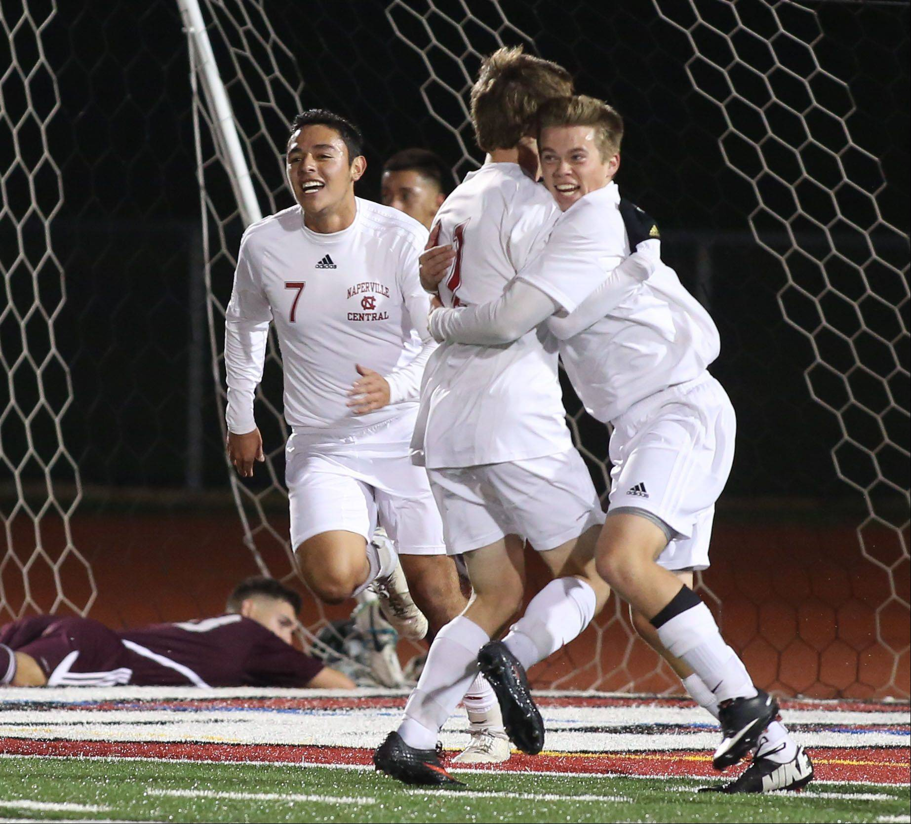 Naperville Central soccer players celebrate during Tuesday's Class 3A supersectional match in Romeoville.