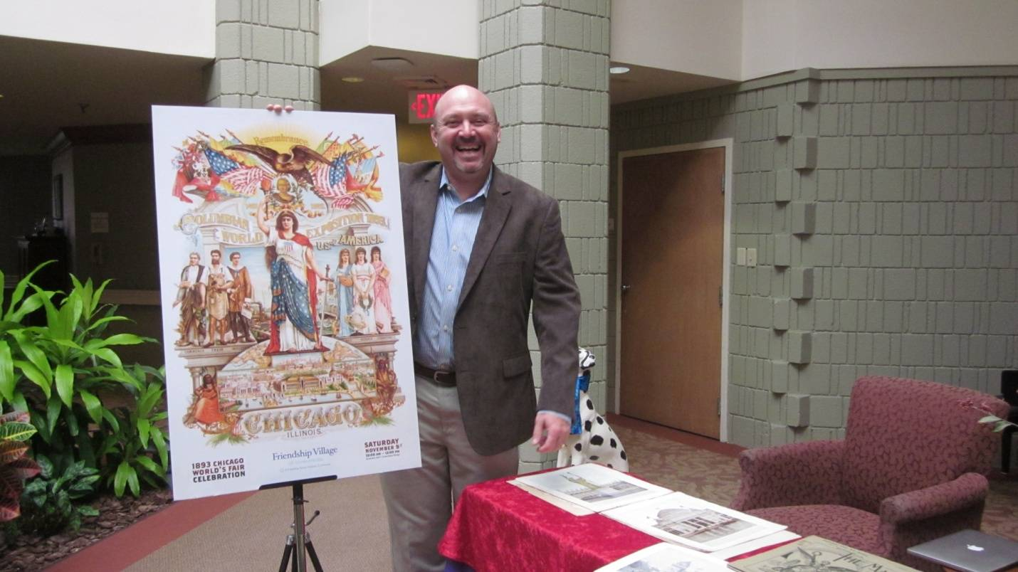 Bob Dion proudly displays the poster used to promote the 1893 Columbia Exposition.