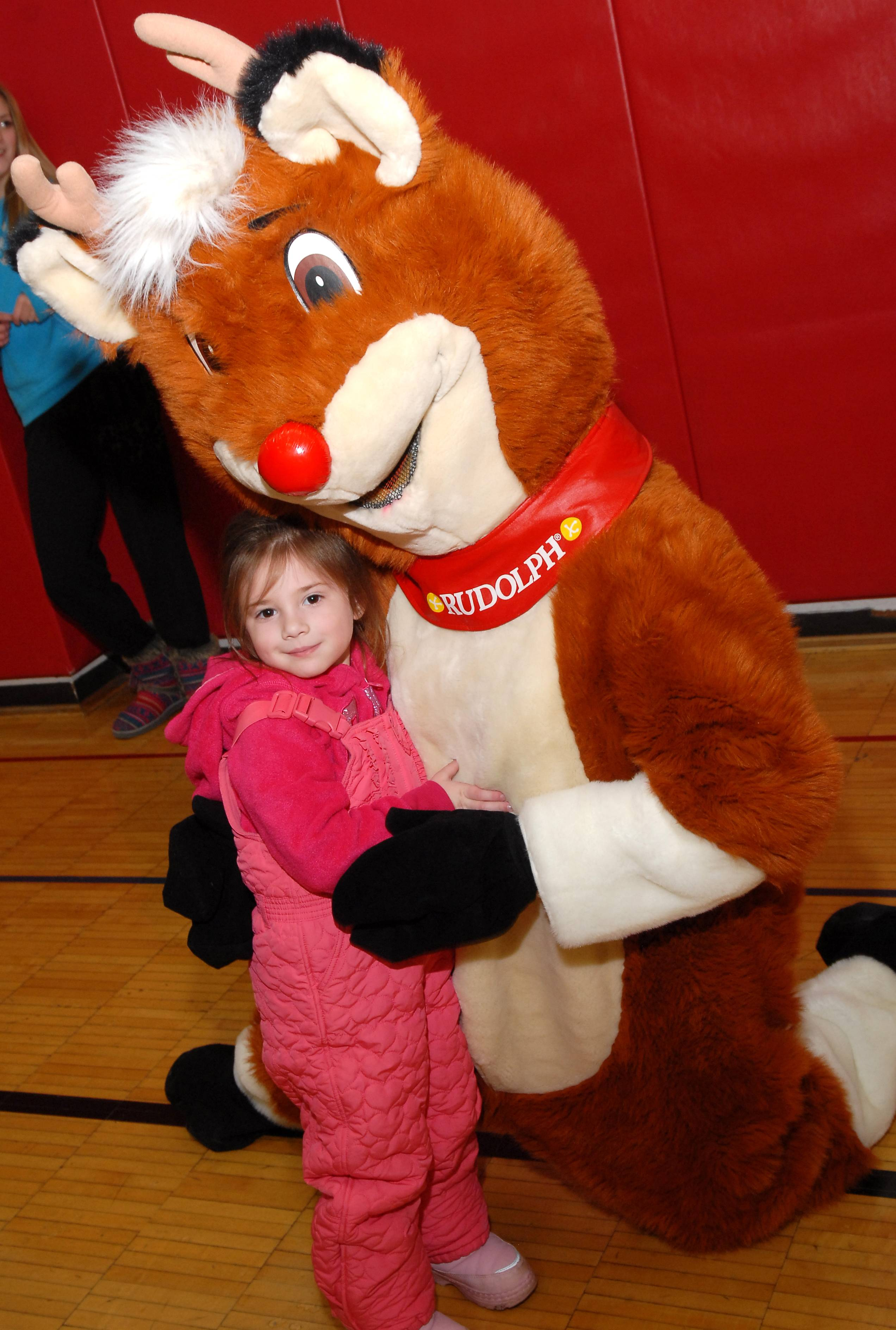 A youth participant meets Rudolph at last year's event.