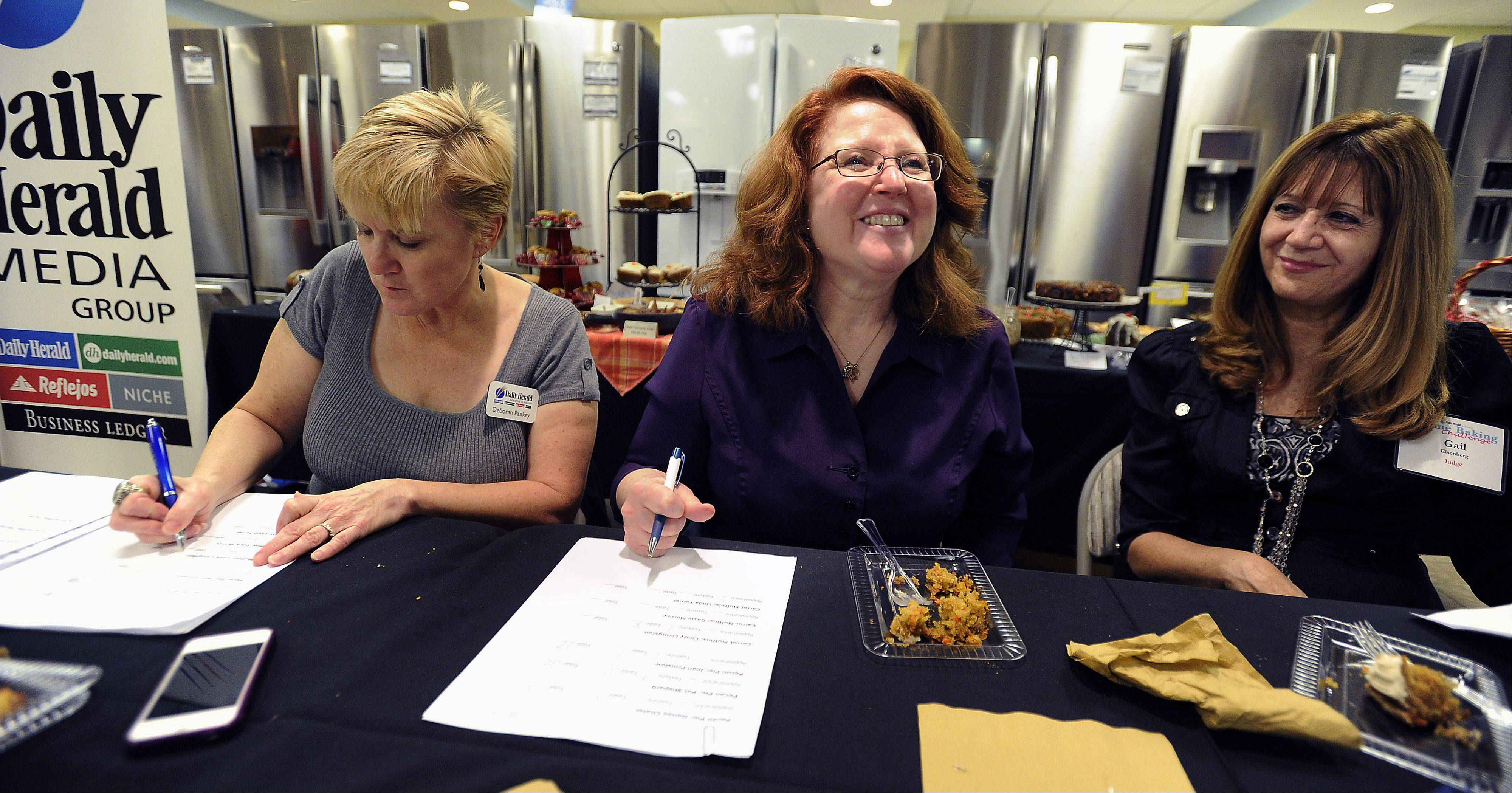 Daily Herald Food Editor Deborah Pankey tastes entries in the Daily Herald's Home Baking Challenge along with Baking Secrets columnist Annie Overboe and Gail Eisenberg of Gail's Brownie's in Buffalo Grove.