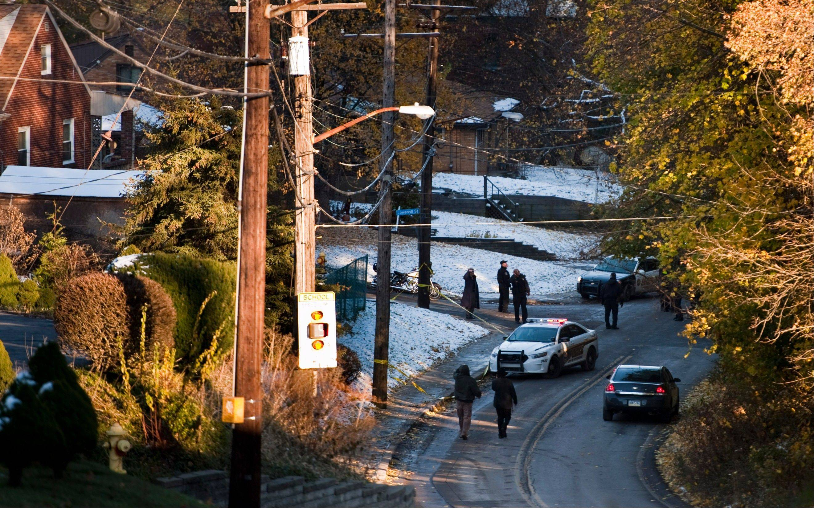 Police are seen in an area near Brashear High School in PIttsburgh on Wednesday after three students were shot outside the Pittsburgh high school.