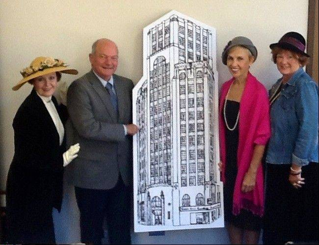 From left, ball co-chairwoman Mary Ellen Beckmann, Elgin Mayor David Kaptain, ball co-chairwoman Linda O�Connor and Fideliter Club President Brenda Morrissy pose with a replica of the Elgin Tower Building. Sponsors for notable Elgin buildings are being sought as part of this year�s fundraiser.