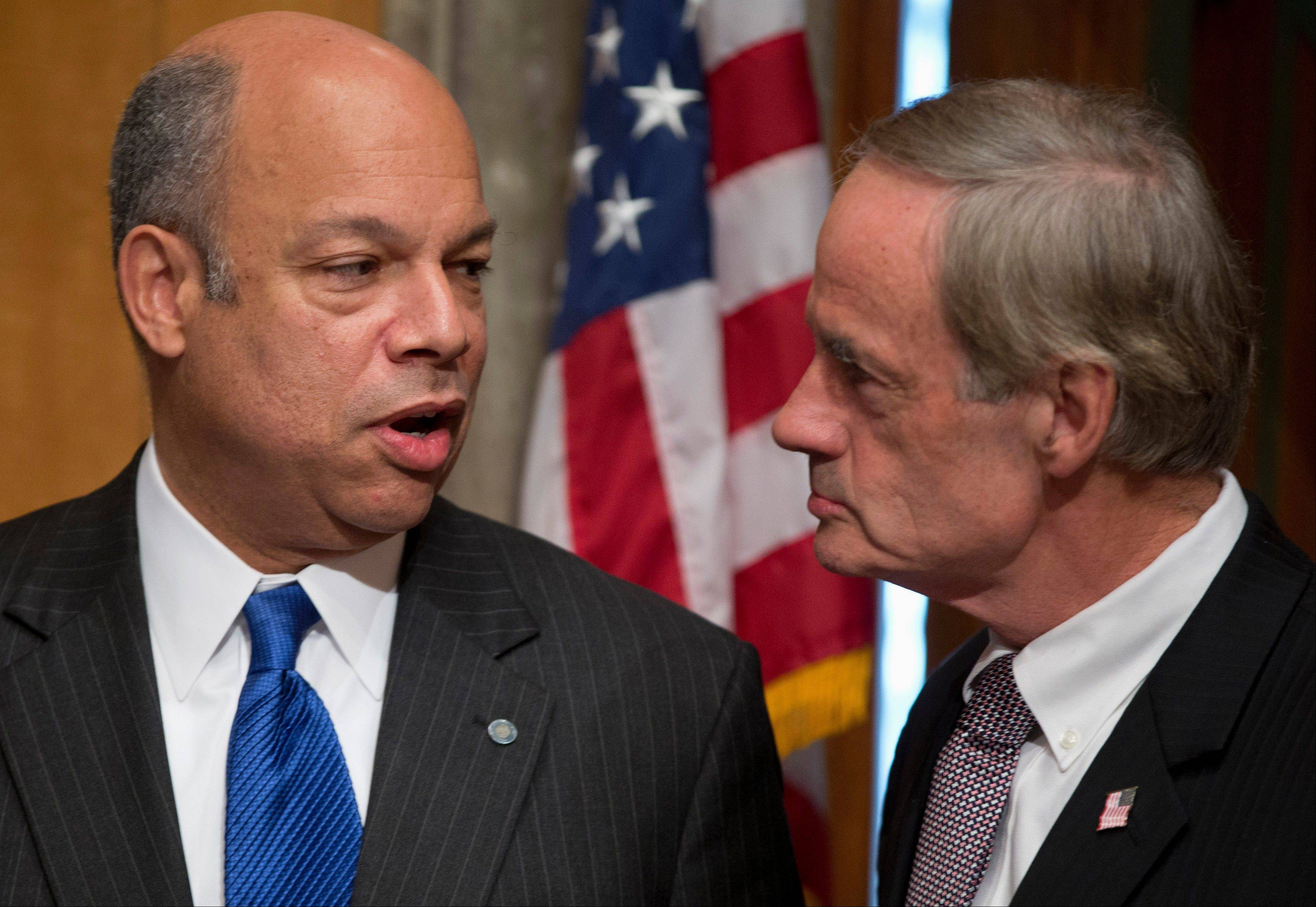 Jeh Johnson, President Barack Obama�s choice to become Homeland Security Secretary, left, talks with Senate Homeland Security and Governmental Affairs Committee Chairman Sen. Thomas Carper, D-Del., on Capitol Hill in Washington, Wednesday, Nov. 13, 2013, before the start of the committee�s hearing Johnson�s nomination.