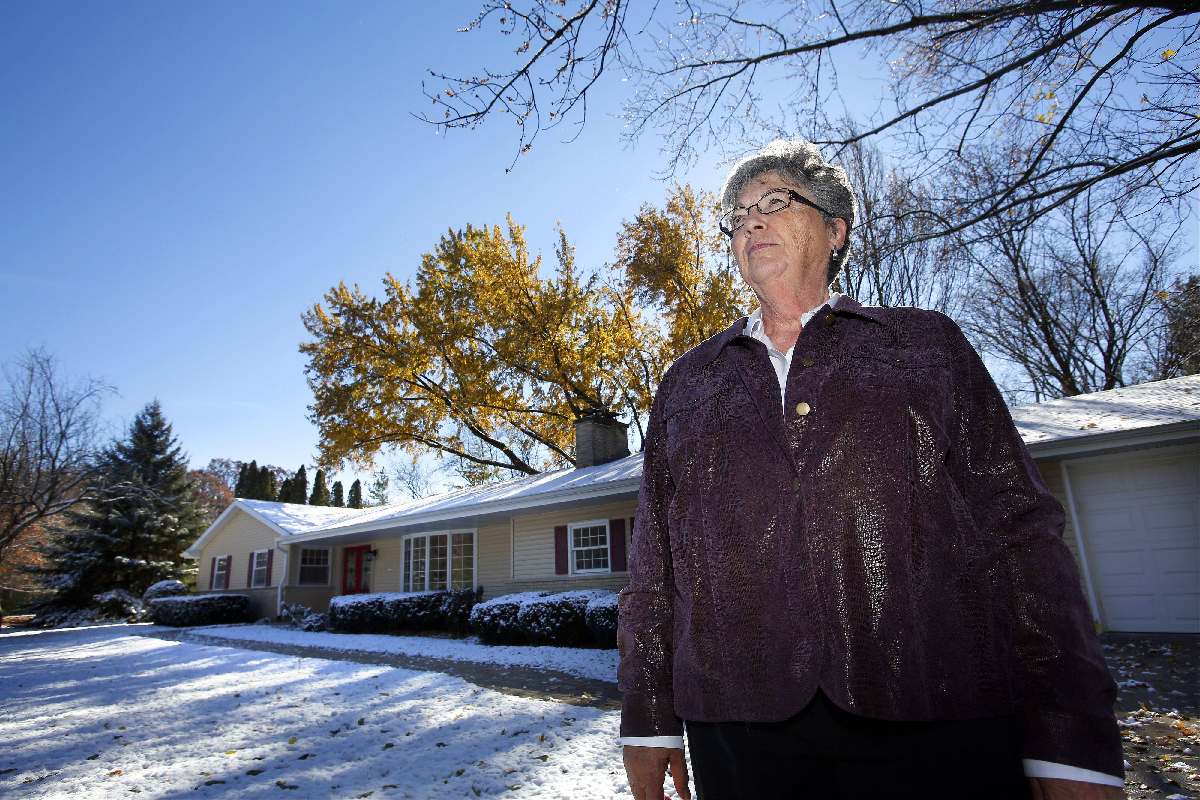 While the assessed value of her Crystal Lake house has decreased by $12,000 over the past two years, Barbara Rogers' property tax bill increased $900.