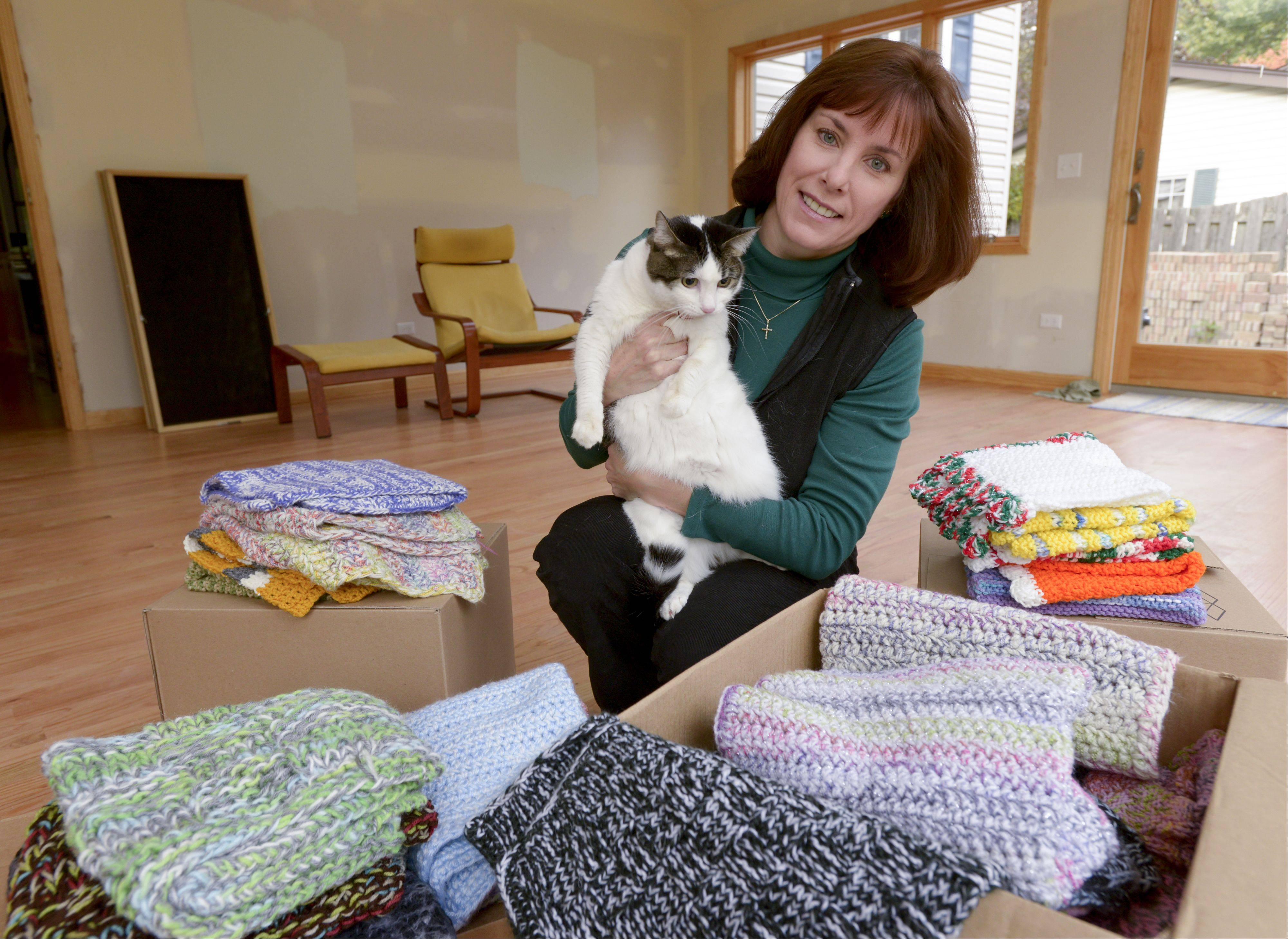 Linda Kozlowski holds Anna, the cat she adopted from DuPage Animal Control in 2007. Wanting to do something for the animals she couldn't take home, Kozlowski started crocheting blankets and started Comfort for Critters to provide handmade blankets for shelter animals.