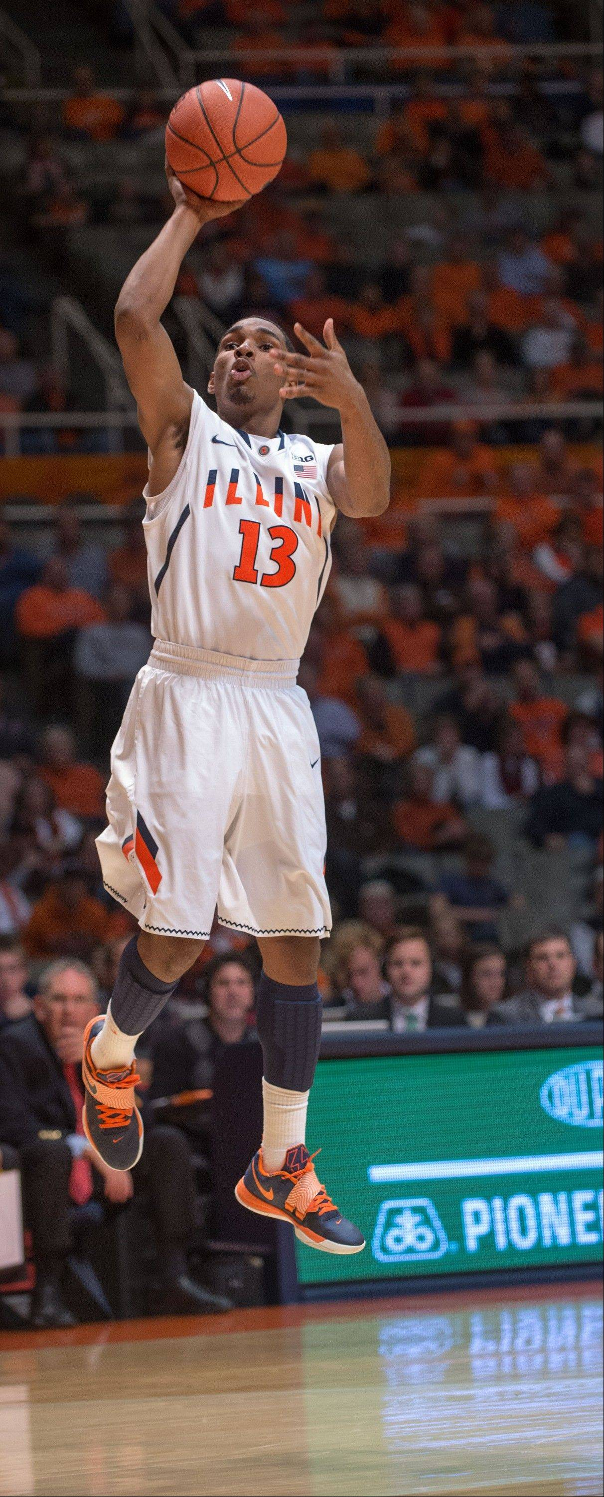 Illinois' Tracy Abrams (13) shoots a three-point basket during the first half of an NCAA college basketball game on Wednesday Nov. 13, 2013, in Champaign, Ill. (AP Photo/Darrell Hoemann)