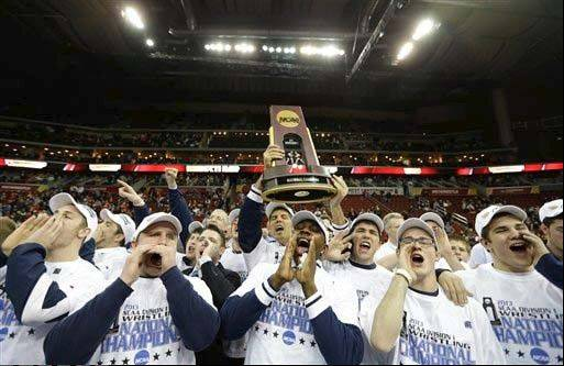 Penn State wrestlers celebrate with the trophy after winning the NCAA team championship last March in Des Moines, Iowa.