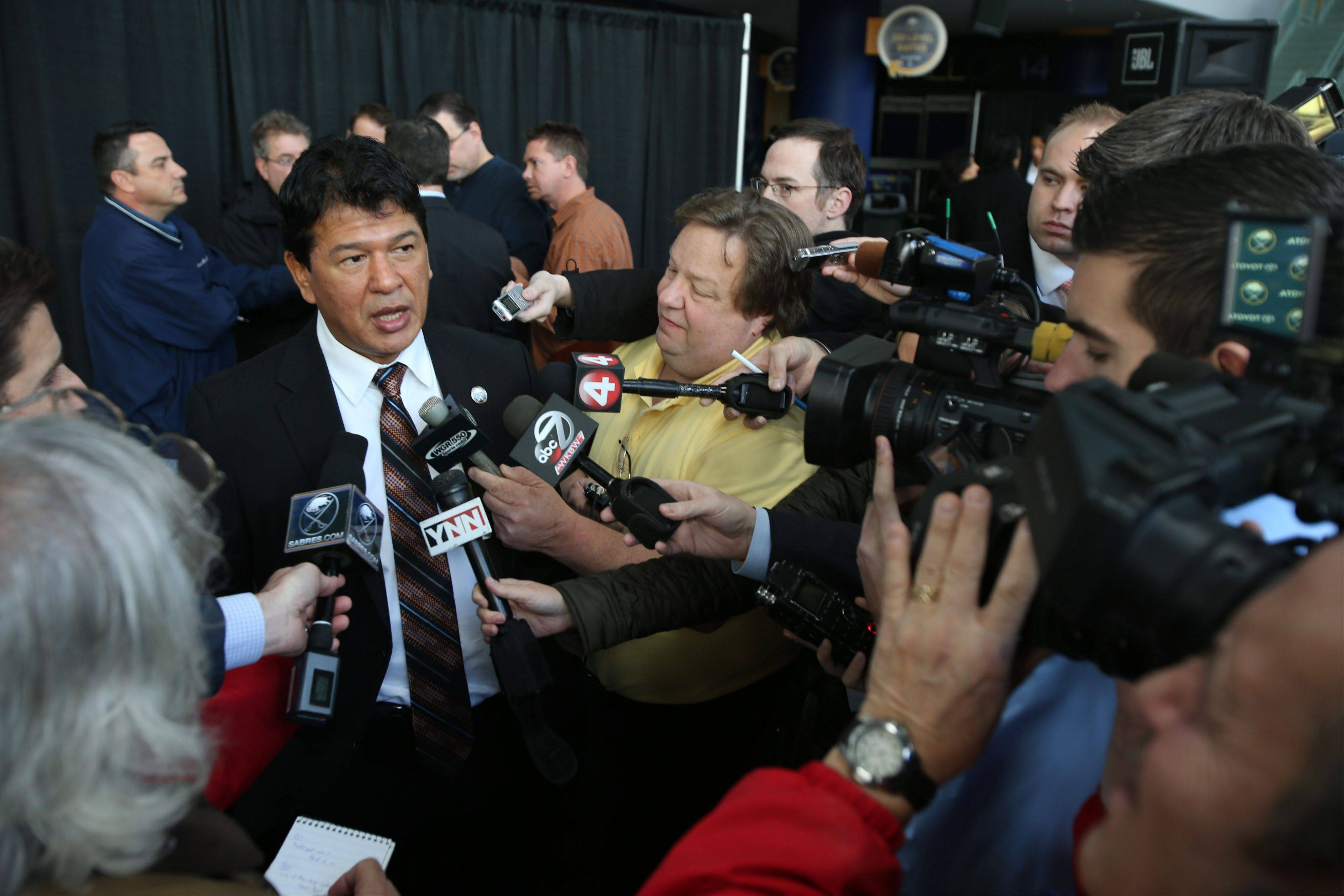 Ted Nolan, new head coach of the Buffalo Sabres, is interviewed by the media following a news conference Wednesday. (AP Photo/The Buffalo News, Charles Lewis)
