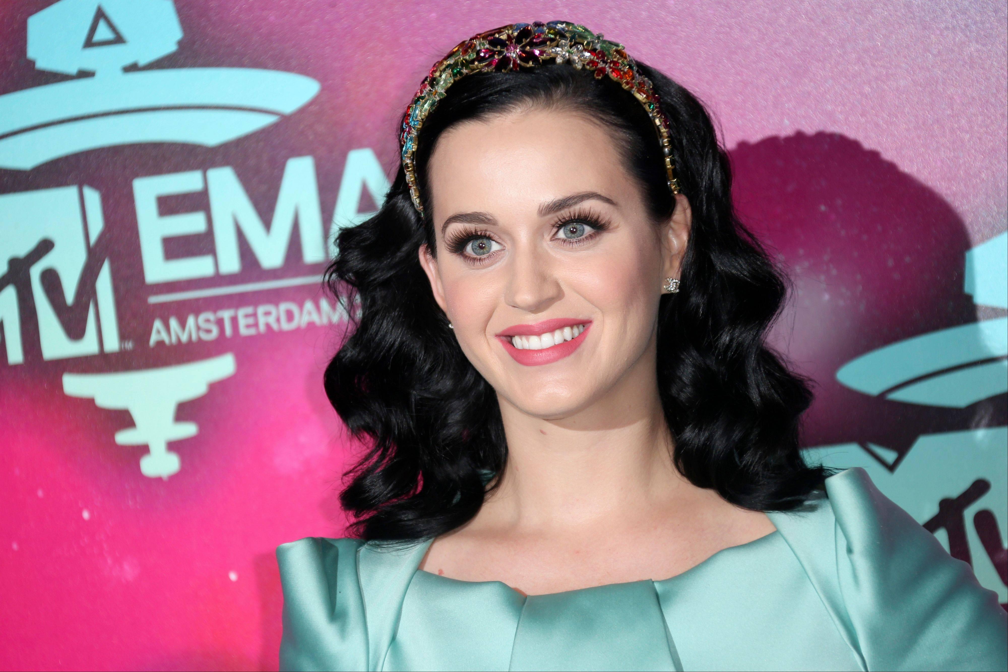 "Katy Perry will kick off the Nov. 24 American Music Awards with a performance of her new single ""Unconditionally."""