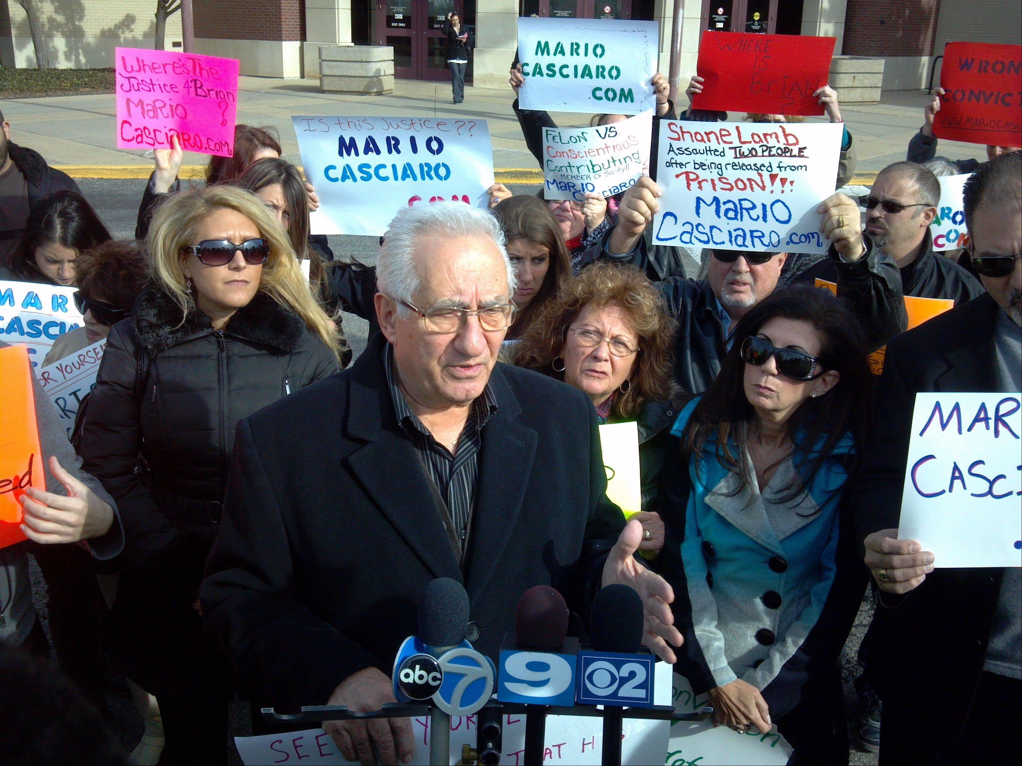 Surrounded by family members and supporters outside the McHenry County courthouse, Jerry Casciaro announces a $25,000 reward for information about the location of Brian Carrick's body. Casciaro's son, Mario, was sentenced to 26 years in prison Thursday after being convicted of Carrick's 2002 murder earlier this year.