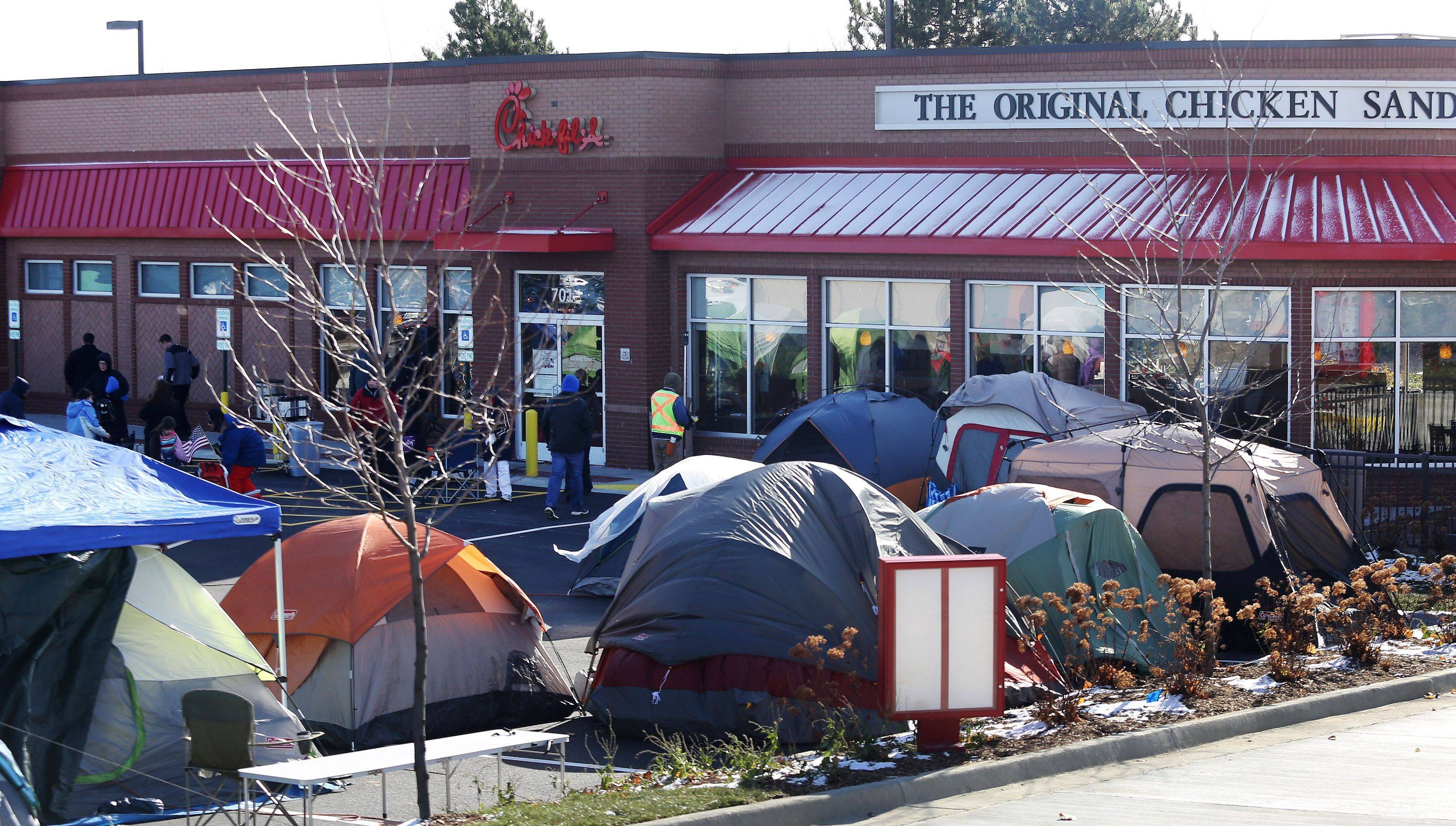 On a blustery, cold morning, 96 people created a tent city Wednesday outside the new Chick-fil-A in Vernon Hills. The first 100 customers waiting in line when the restaurant opens Thursday will receive a free meal a week for the next year.