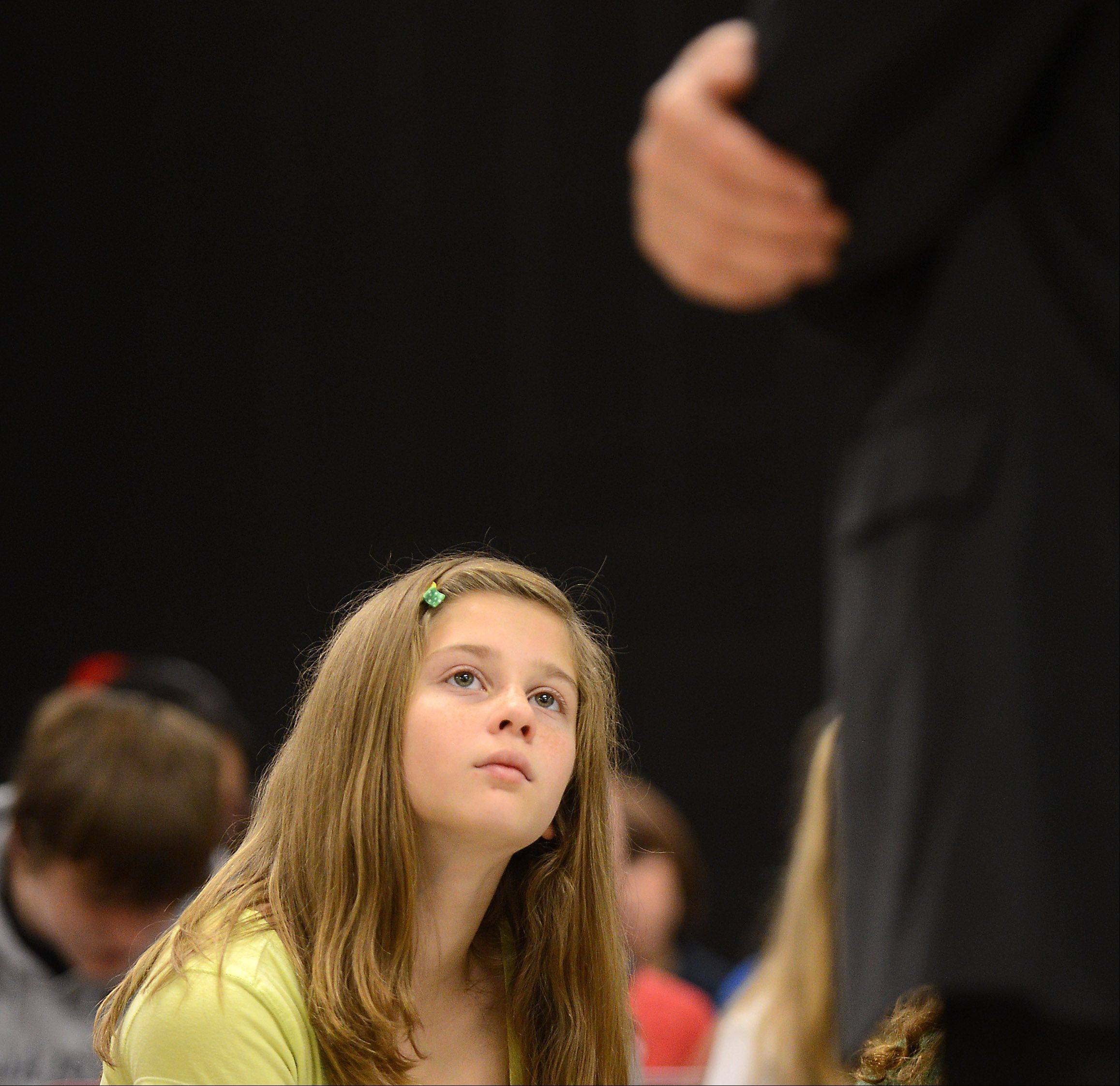 Thompson Middle School sixth-grader Sophia Falese listens as St. Charles City Administrator Mark Koenen answers a question posed by social studies students Wednesday at the school. Koenen was joined by Mayor Ray Rogina.