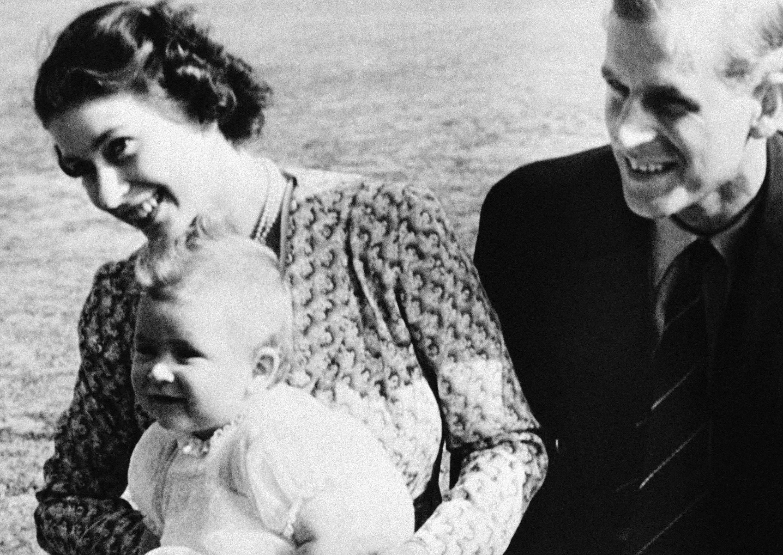 Associated Press File Photo, 1949An eight-month-old Prince Charles with his mother, then-Princess Elizabeth of England, and his father, Philip.