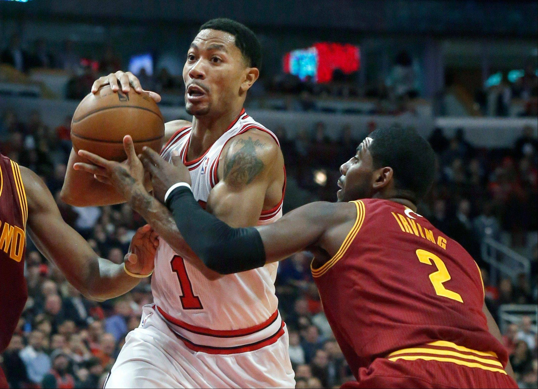 Derrick Rose, driving past Cleveland's Kyrie Irving during Monday's victory over the Cavaliers, did not practice Wednesday as he nurses a hamstring injury.