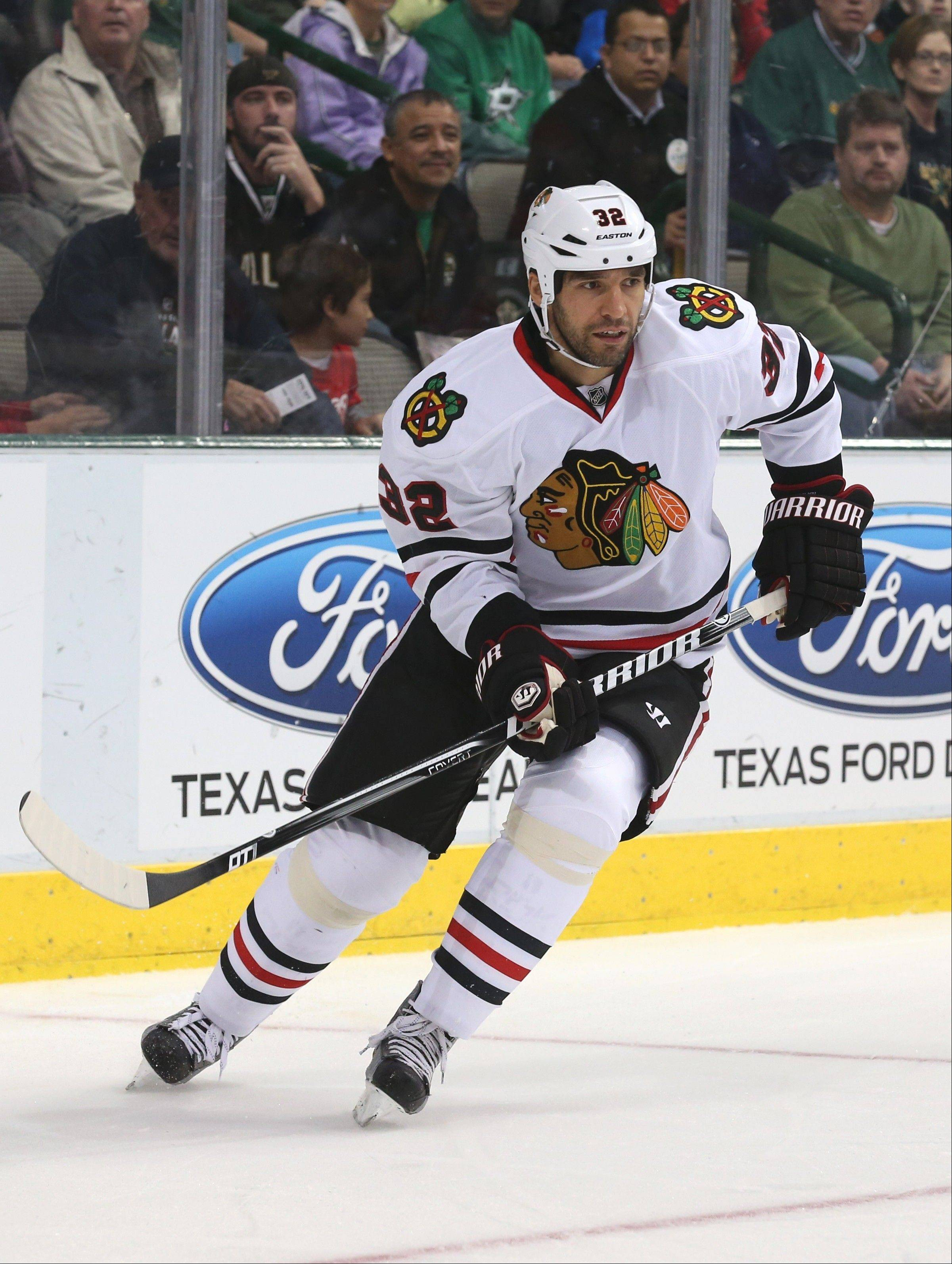 Hawks defenseman Michal Rozsival practiced Wednesday after a scary moment on the bench during Sunday's victory over Edmonton.