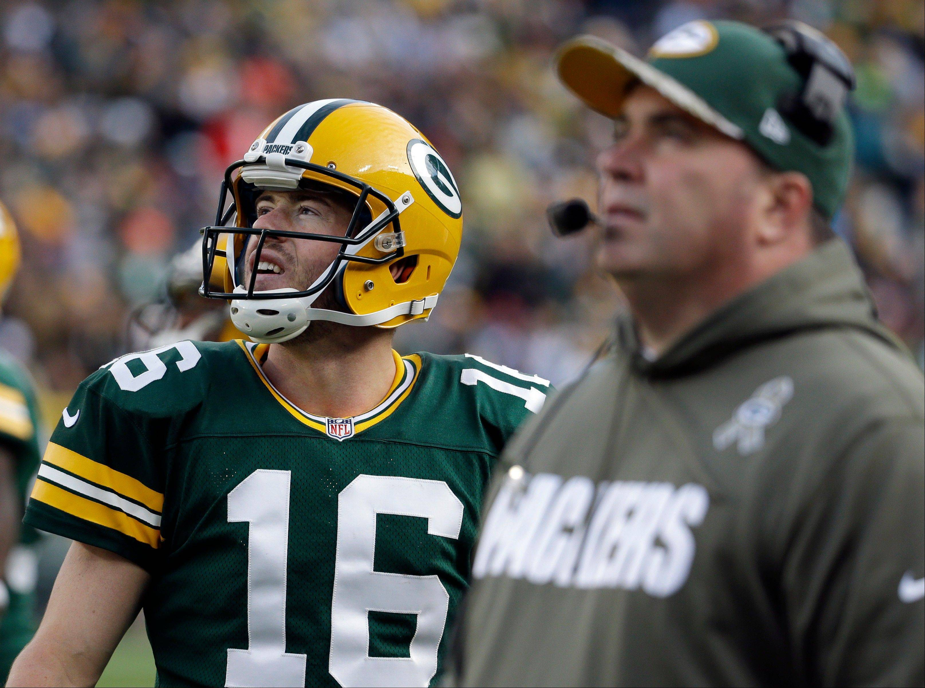 Green Bay Packers head coach Mike McCarthy and quarterback Scott Tolzien look at a video board during the second half of an NFL football game against the Philadelphia Eagles Sunday, Nov. 10, 2013, in Green Bay, Wis. The Eagles won 27-13.