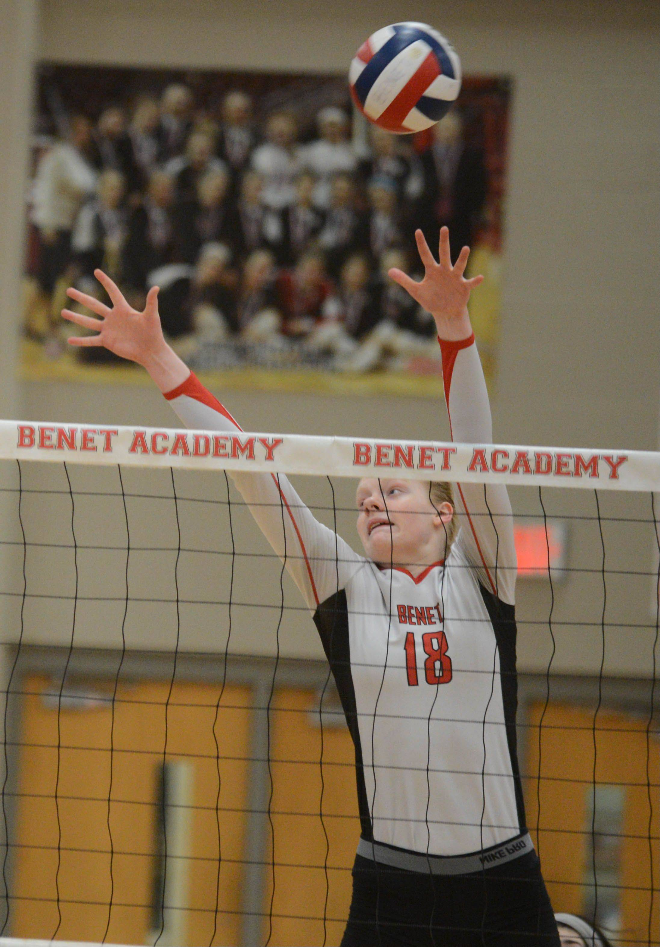 Rachael Fara of Benet goes up for the ball against Joliet Catholic.