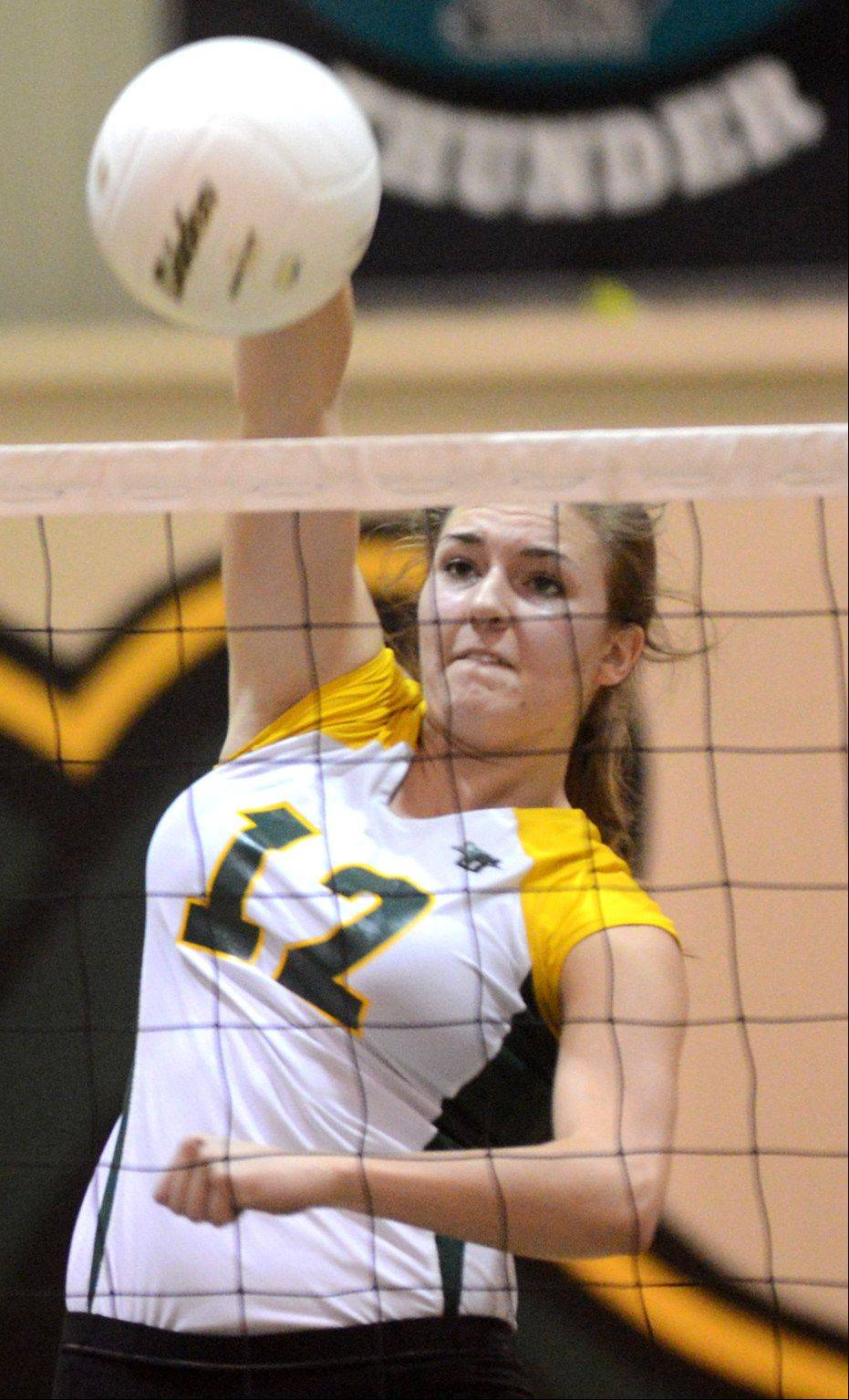 Crystal Lake South's Nicole Slimko hammers the ball against Huntley.