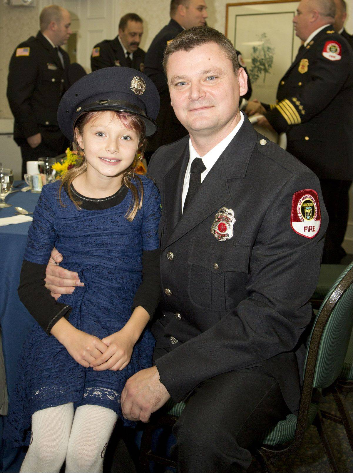 Marek Kokosinski, firefighter/paramedic with the Mundelein Fire Department, with his daughter Anna at the A Cut Above Award Ceremony for first responders at Northwestern Lake Forest Hospital.