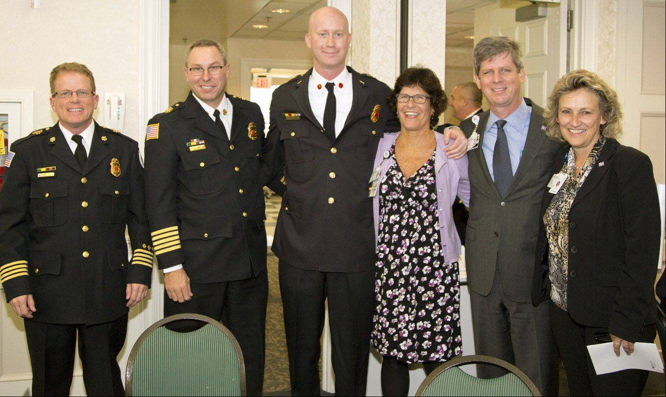 At the A Cut Above Award Ceremony for first responders at Northwestern Lake Forest Hospital: Deputy Chief Greg Formica, Chief John Christian and Lieutenant Mike Higgins, all of the Grayslake Fire Department; Mary Ann Zemla, RN, Northwestern Grayslake; Thomas A. McAfee, president of Northwestern Lake Forest Hospital; and Dawn Frank, RN, director of Northwestern Grayslake Emergency Center.
