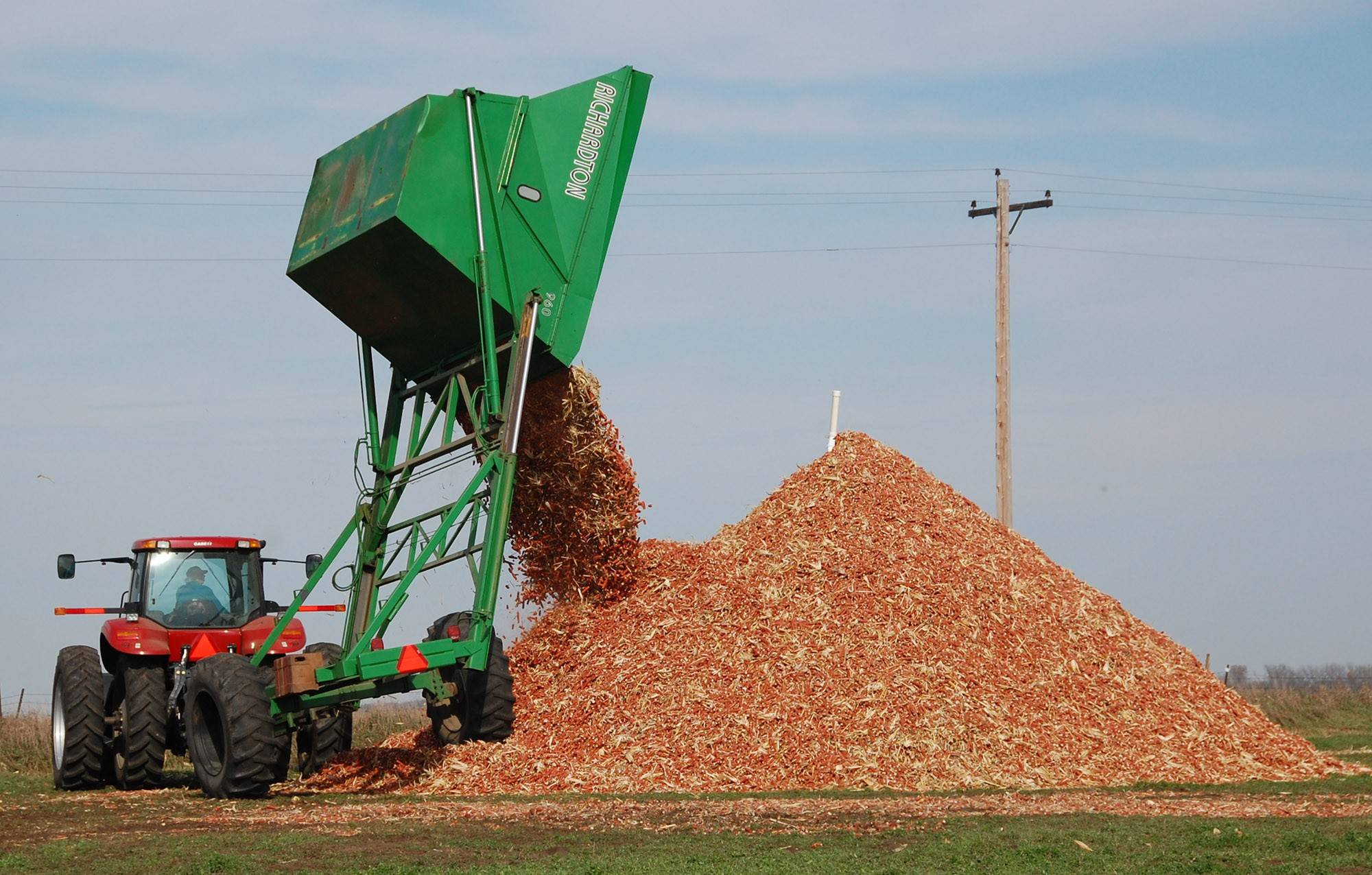 A dump wagon adds freshly gathered corn cobs to a pile on a farm near Hurley, S.D. The first trickle of fuels made from agricultural waste, including corn cobs, is finally winding its way into the nation's energy supply, after years of broken promises and hype promoting a next-generation fuel source cleaner than oil.