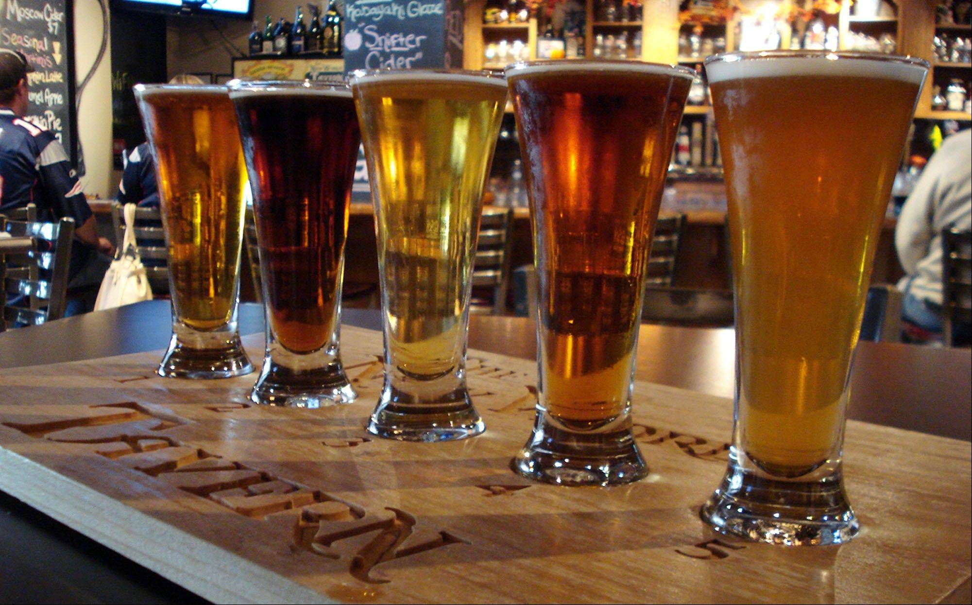 Customers can try a beer flight — 4-ounce samples of five beers — at The New World Tavern in Plymouth, Mass.