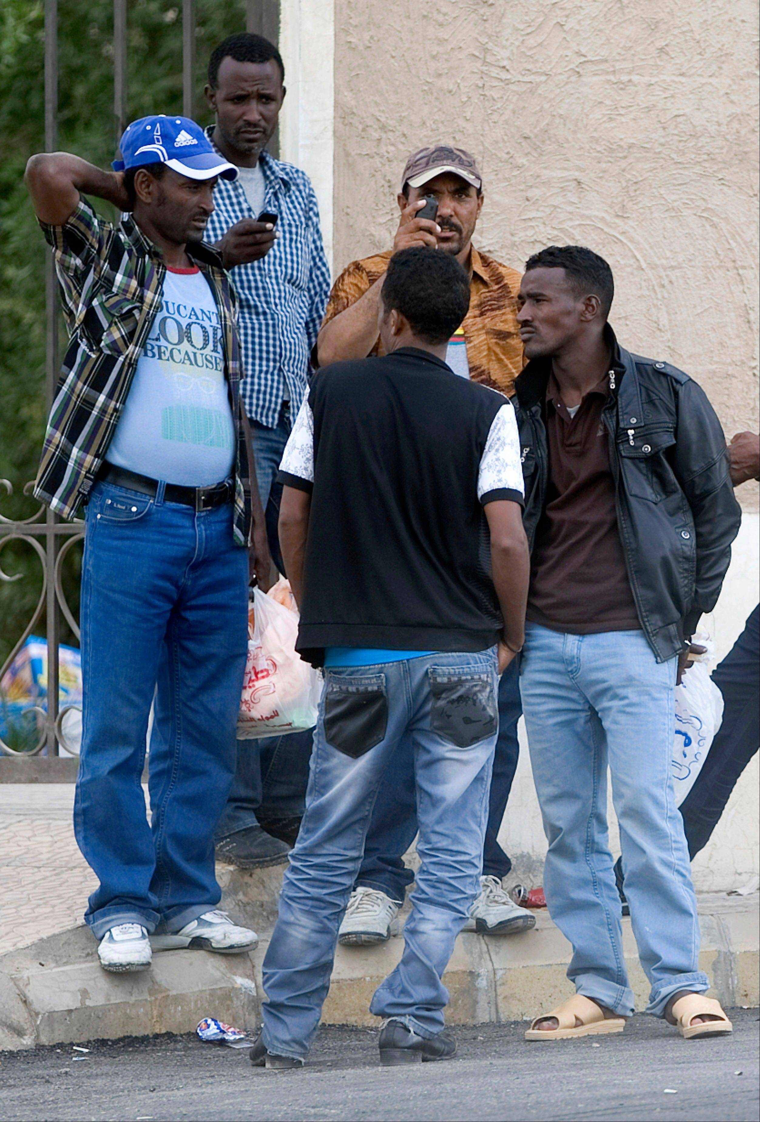 Ethiopians gather as they wait to be repatriated in Saudi Arabia. The country�s crackdown on migrant workers, which began Nov. 4, targets the more than 9 million foreign laborers.