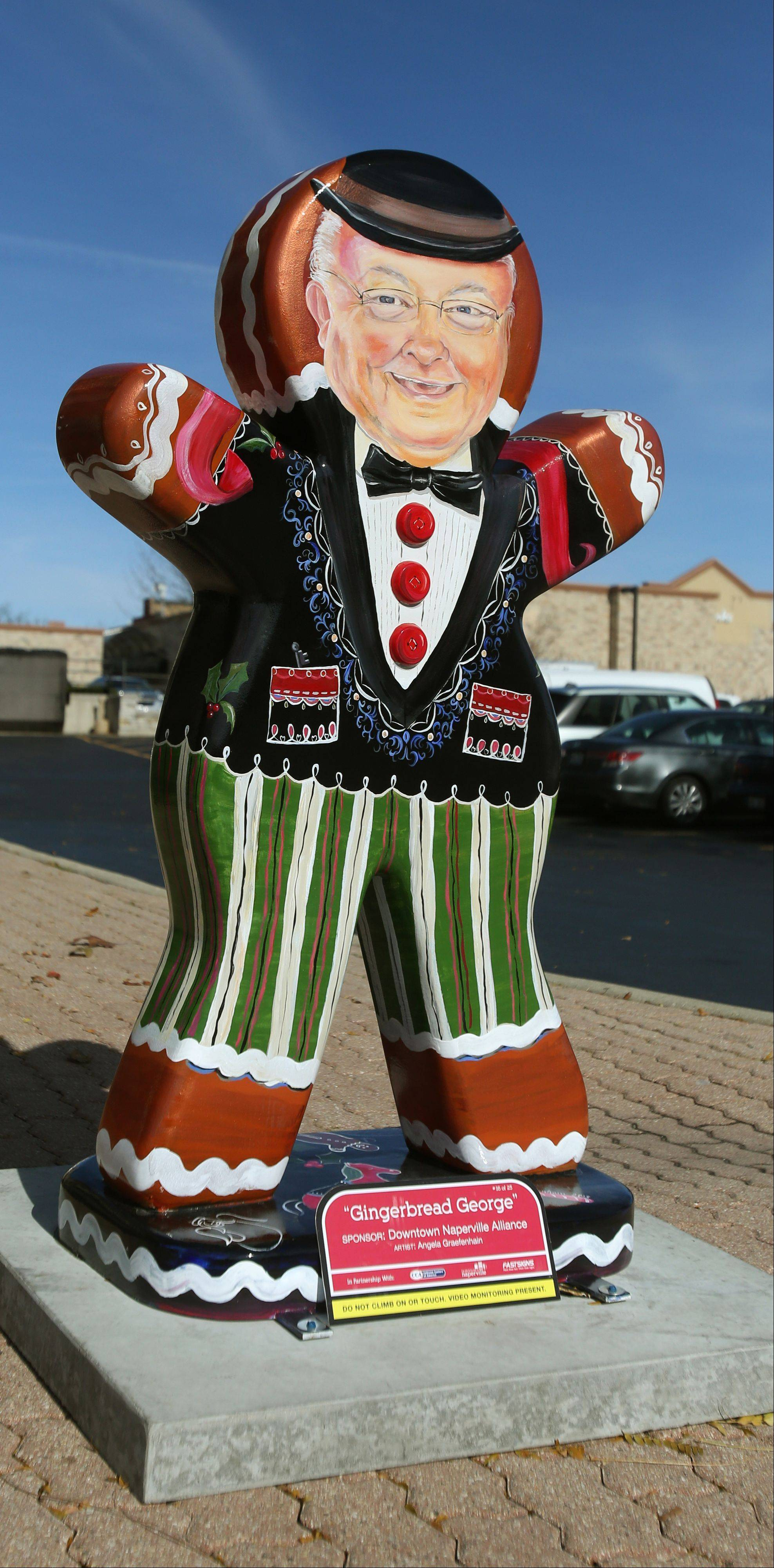 """Gingerbread George,"" designed to look like Naperville Mayor George Pradel, is one of 25 decorated gingerbread sculptures on display in downtown Naperville throughout the holiday season. Visitors can vote for their favorite at downtownnaperville.com/gingerbread."