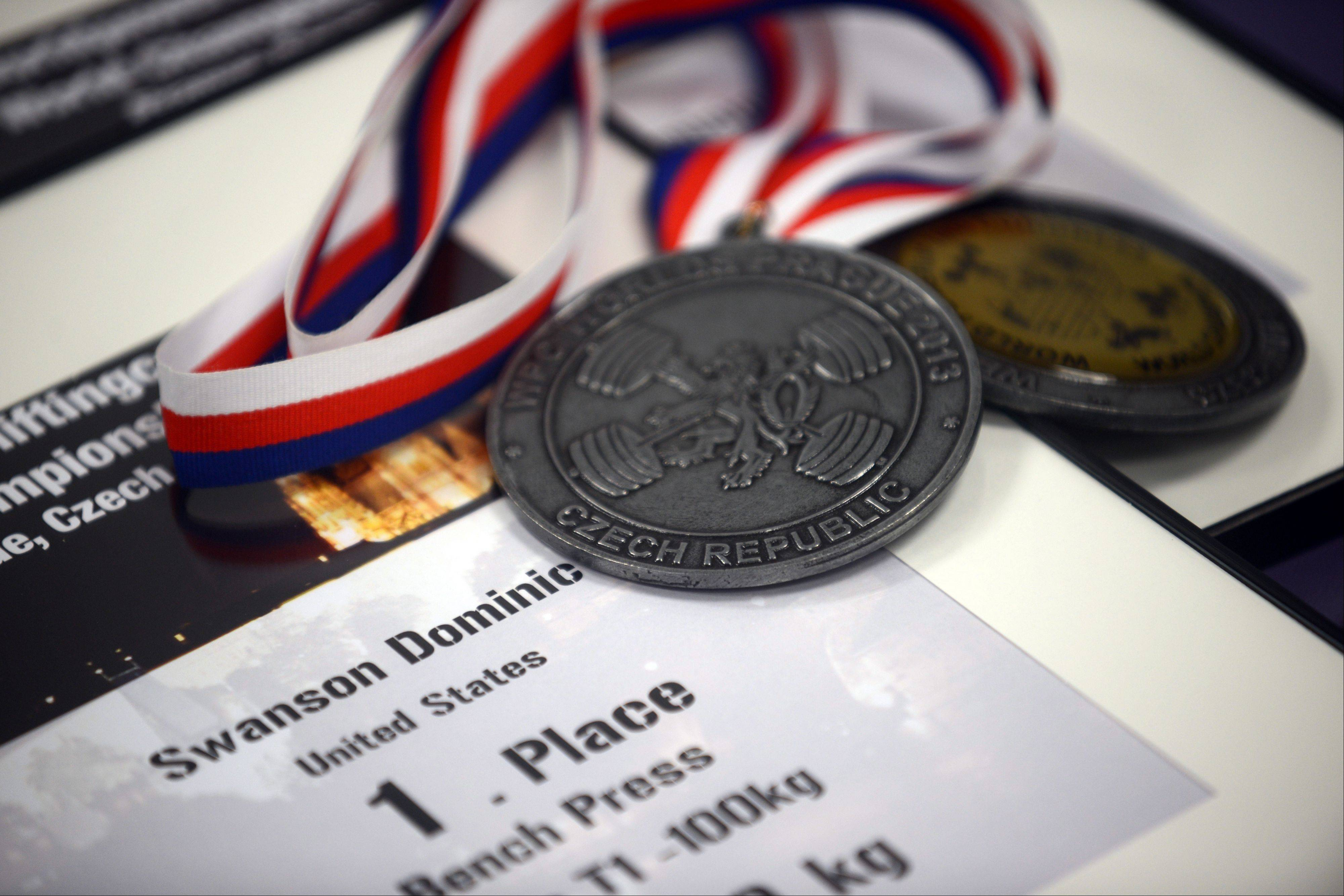 The medals won by Dominic Swanson at the World Powerlifting Congress World Championships in Prague.