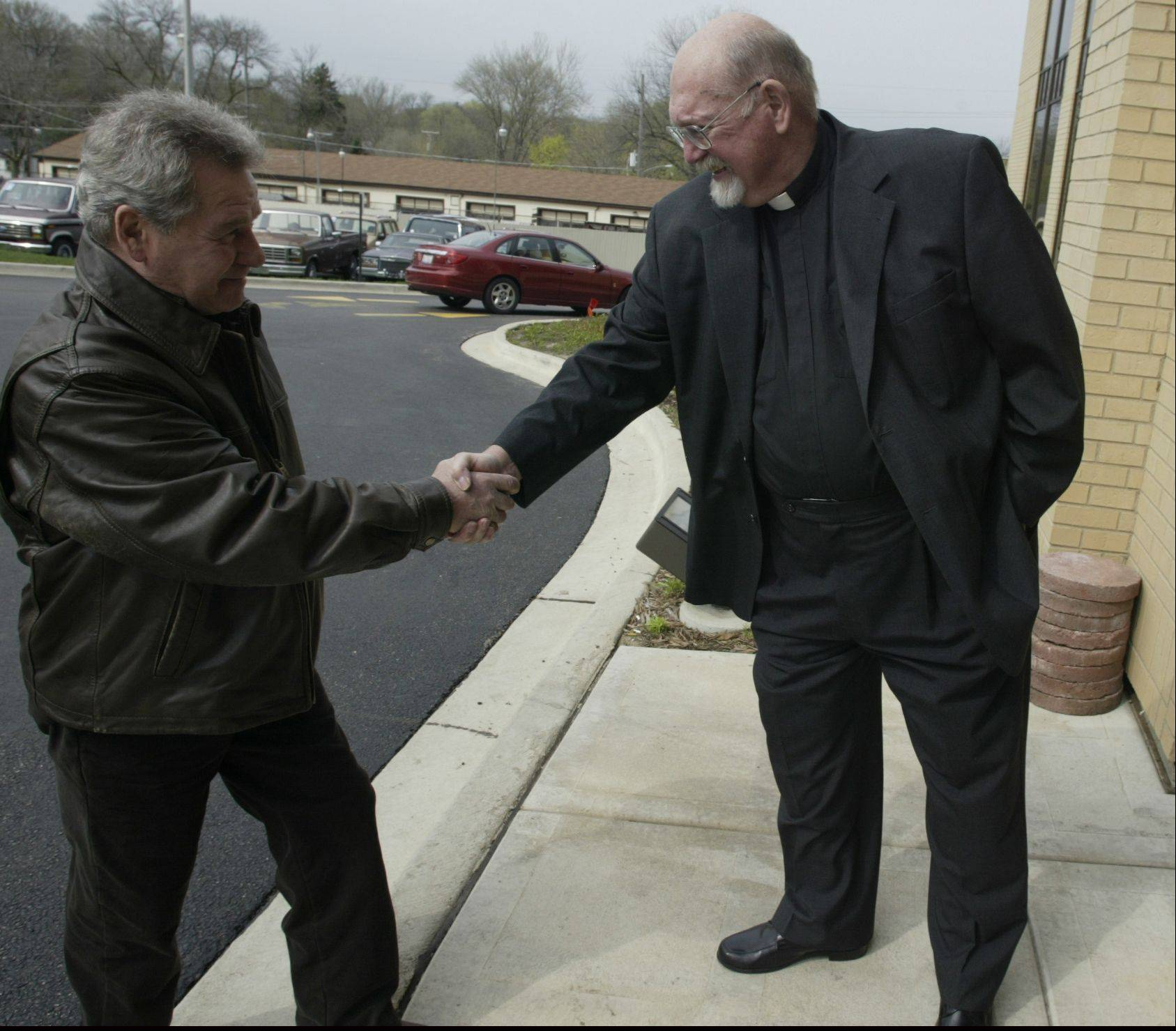 Associate Pastor the Rev. Bruce Meissner, right, greets a churchgoer at Immanuel Lutheran Church in East Dundee. This weekend the congregation will celebrate Meissner's 50th anniversary as a pastor within the Lutheran Church Missouri Synod.