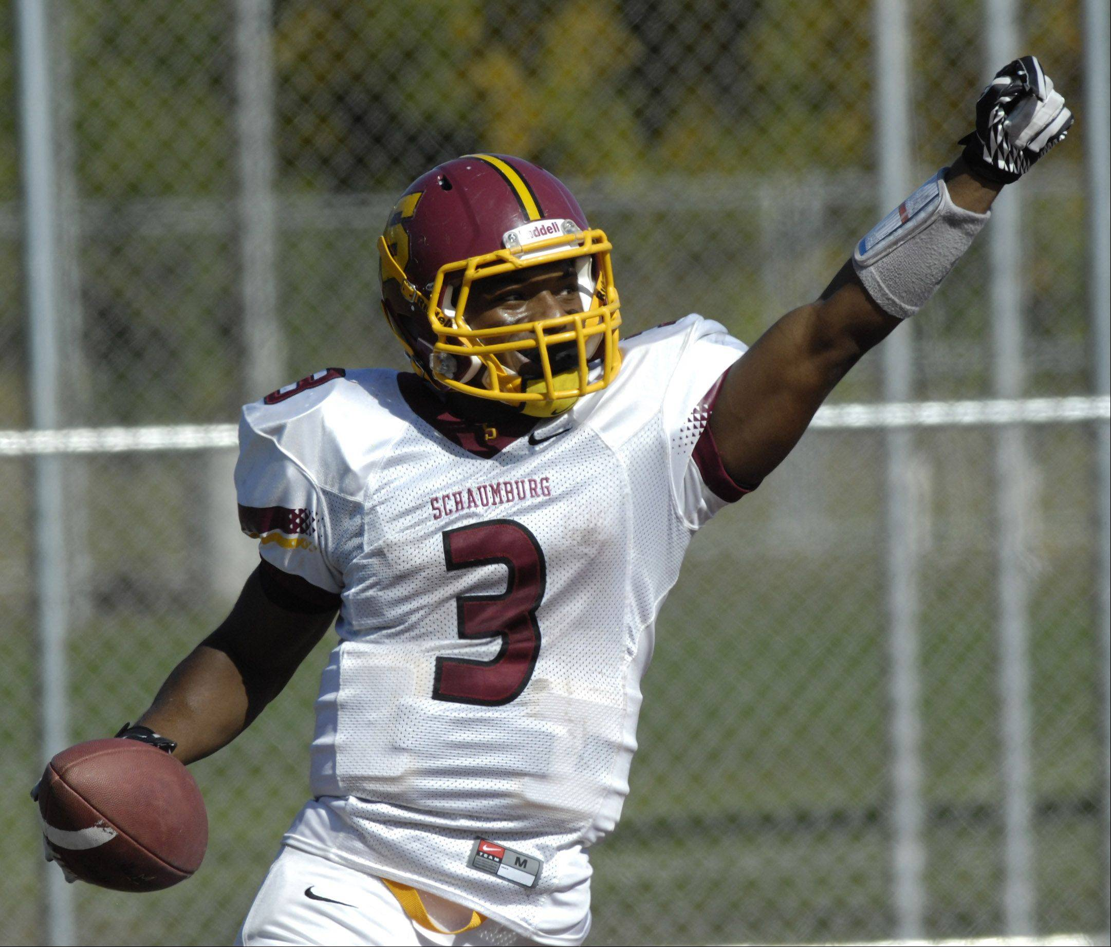 Schaumburg�s Sadarriss Patterson celebrates his second-quarter touchdown in the Saxons� key MSL West victory over Barrington.