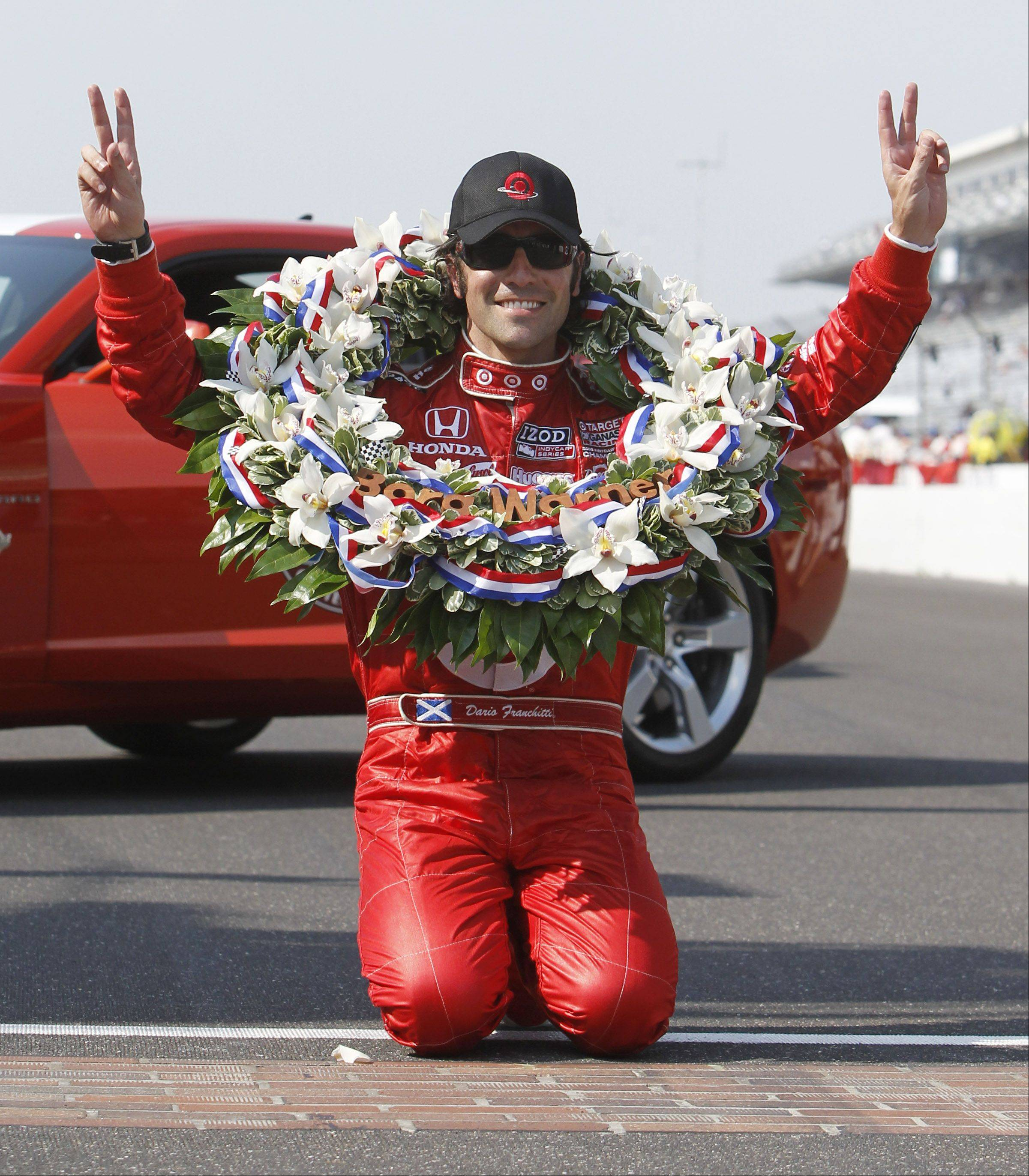 Dario Franchitti, of Scotland, celebrates at the start/finish line after winning the Indianapolis 500 auto race at the Indianapolis Motor Speedway in Indianapolis, Sunday, May 30, 2010. It was his second Indy 500 win.