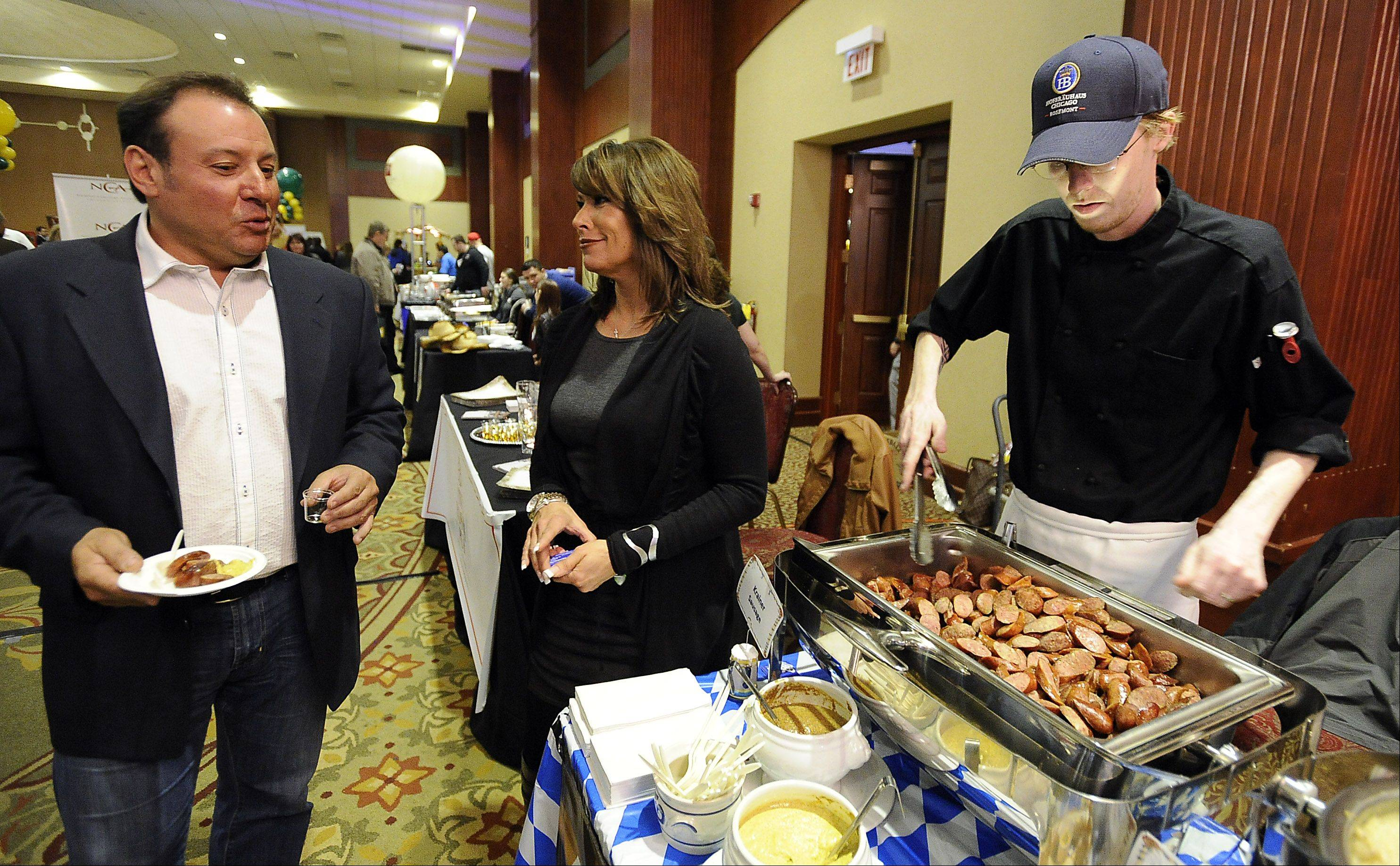 Dominick Mangiardi, independent sales agent for Ignite Payments, LLC. of Palatine talks with Laurel Clark, event sales manager of the Hofbrauhaus Chicago in Rosemont, at Thursday's Northwest Hospitality Expo 2013 at the Meadows Club in Rolling Meadows.