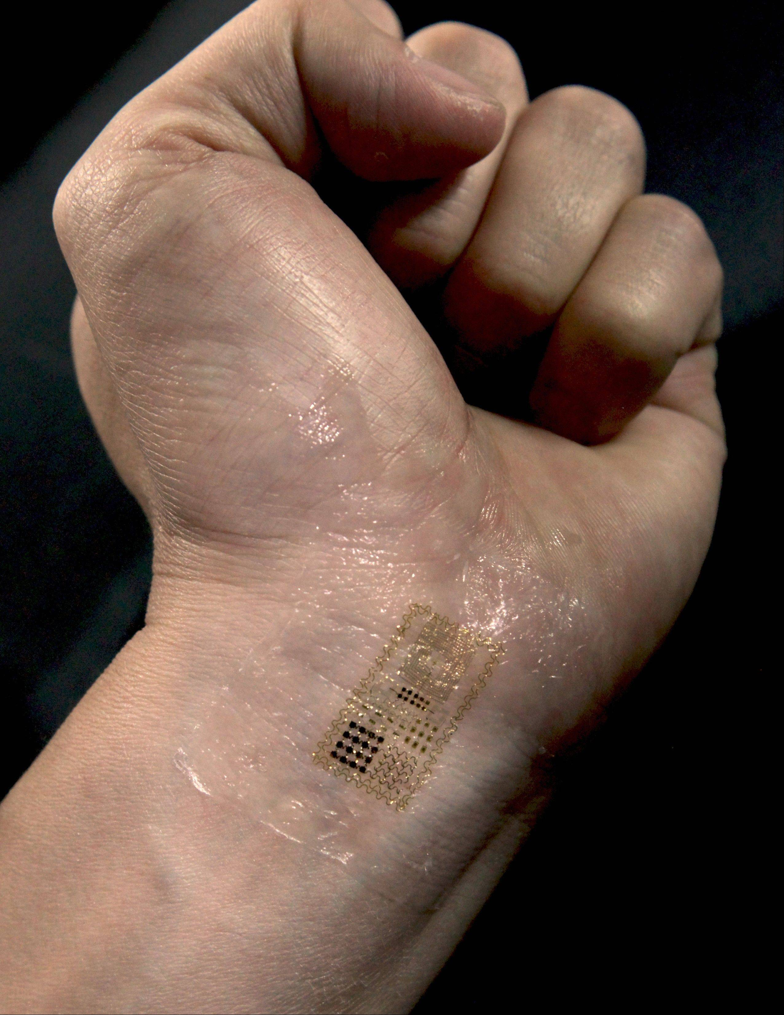 The University of Illinois and Northwestern University researchers published information in 2011 about developing an e-tattoo that could be used for medical diagnostics, communications and human-to-machine interfaces. Motorola Mobility is now seeking a patent on an e-tattoo.