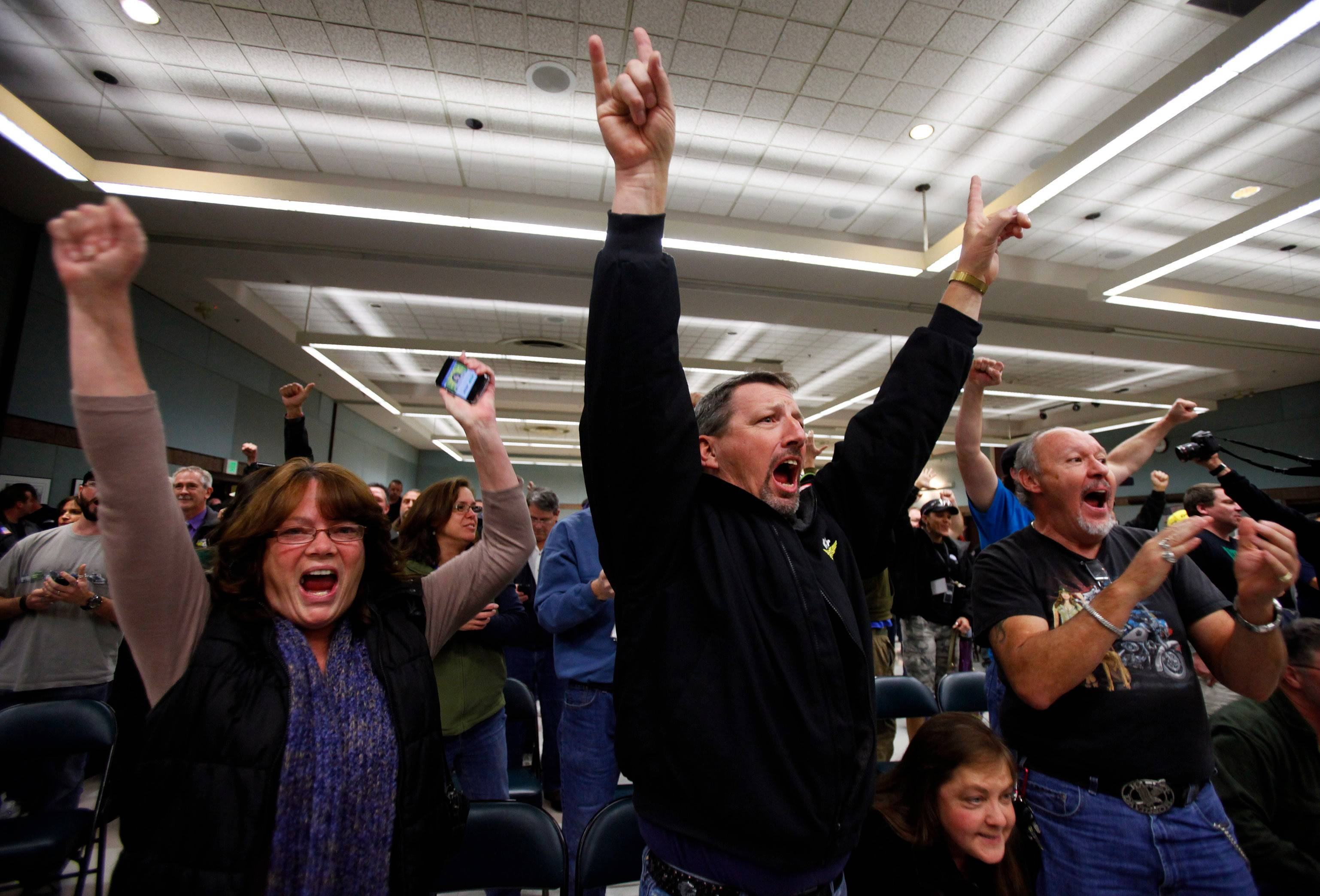 Union members celebrate the turn down of the proposed Boeing Corporation contract Wednesday night at the Internal Association of Machinists District 751 Headquarters in Seattle.