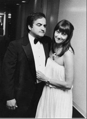 Attending a fancy party, John and Judy Belushi dress accordingly. Dating since their days at Wheaton High School, the couple were married until John Belushi died in 1982 of a drug overdose at age 33.