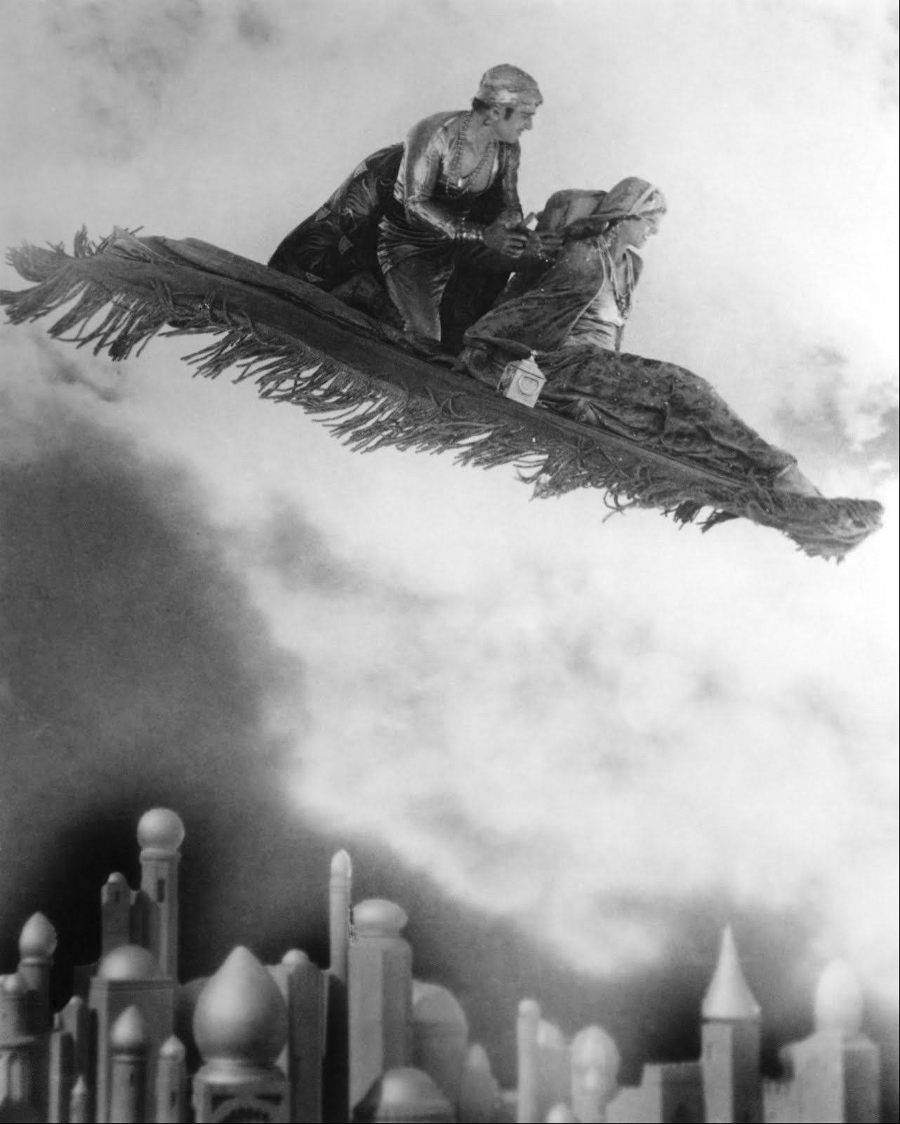 "Douglas Fairbanks uses his flying carpet to pick up women in the 1924 silent classic ""The Thief of Bagdad"" at the Pickwick Theatre in Park Ridge."