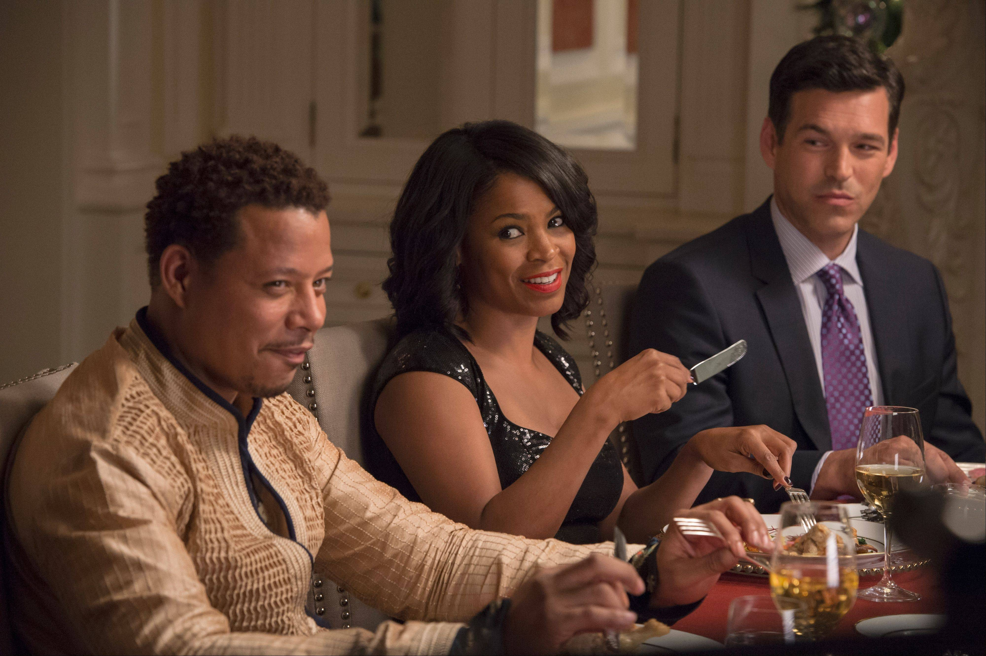 "Quentin (Terrence Howard), left, Jordan (Nia Long) and her boyfriend (Eddie Cibrian) dine in a mansion in Malcolm D. Lee's ""The Best Man Holiday."""