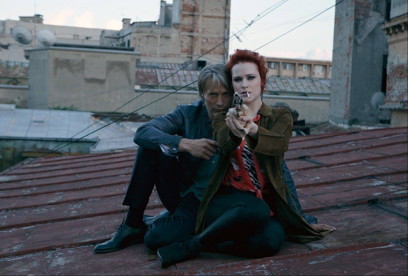 "Nigel (Mads Mikkelsen) and Gabi (Evan Rachel Wood) may not be all that they seem in ""Charlie Countryman."""