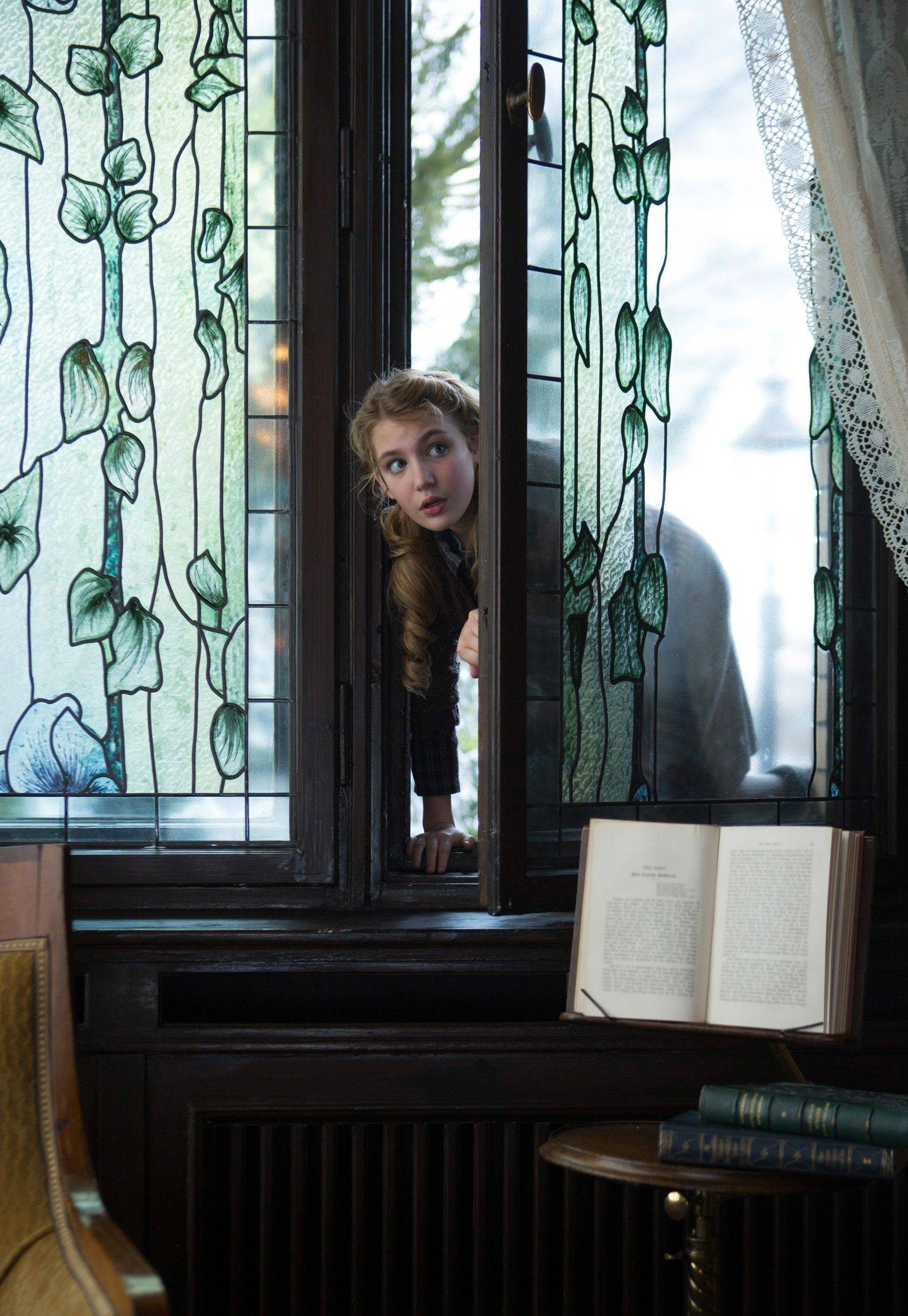 "Liesel (Sophie Nélisse) breaks into the burgomaster's library to snatch some words in ""The Book Thief."""