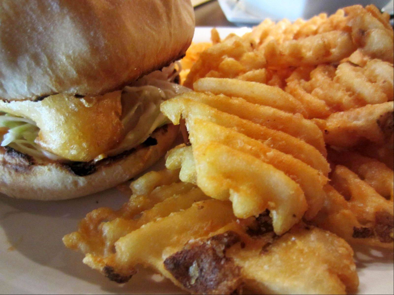 The Cape Cod Reuben features beer-battered fish and hand-cut waffle fries at The New World Tavern in Plymouth, Mass. Plymouth is gearing up for hordes of hungry visitors in the run-up to 2020, when it marks the 400th anniversary of the Mayflower landing.