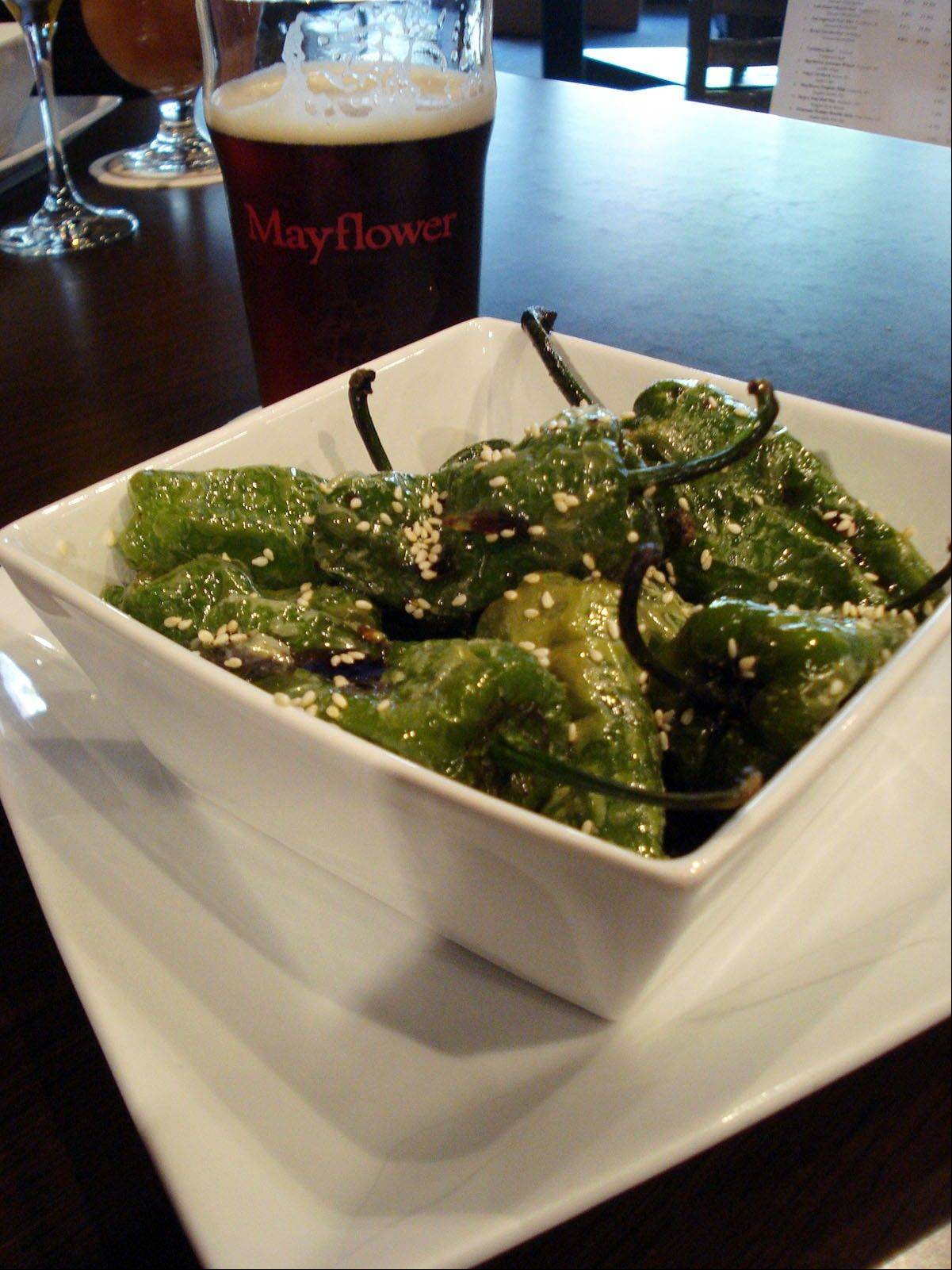Imaginative alternatives to pub grub at The New World Tavern include flash-fried Padron peppers glazed with kabayaki.